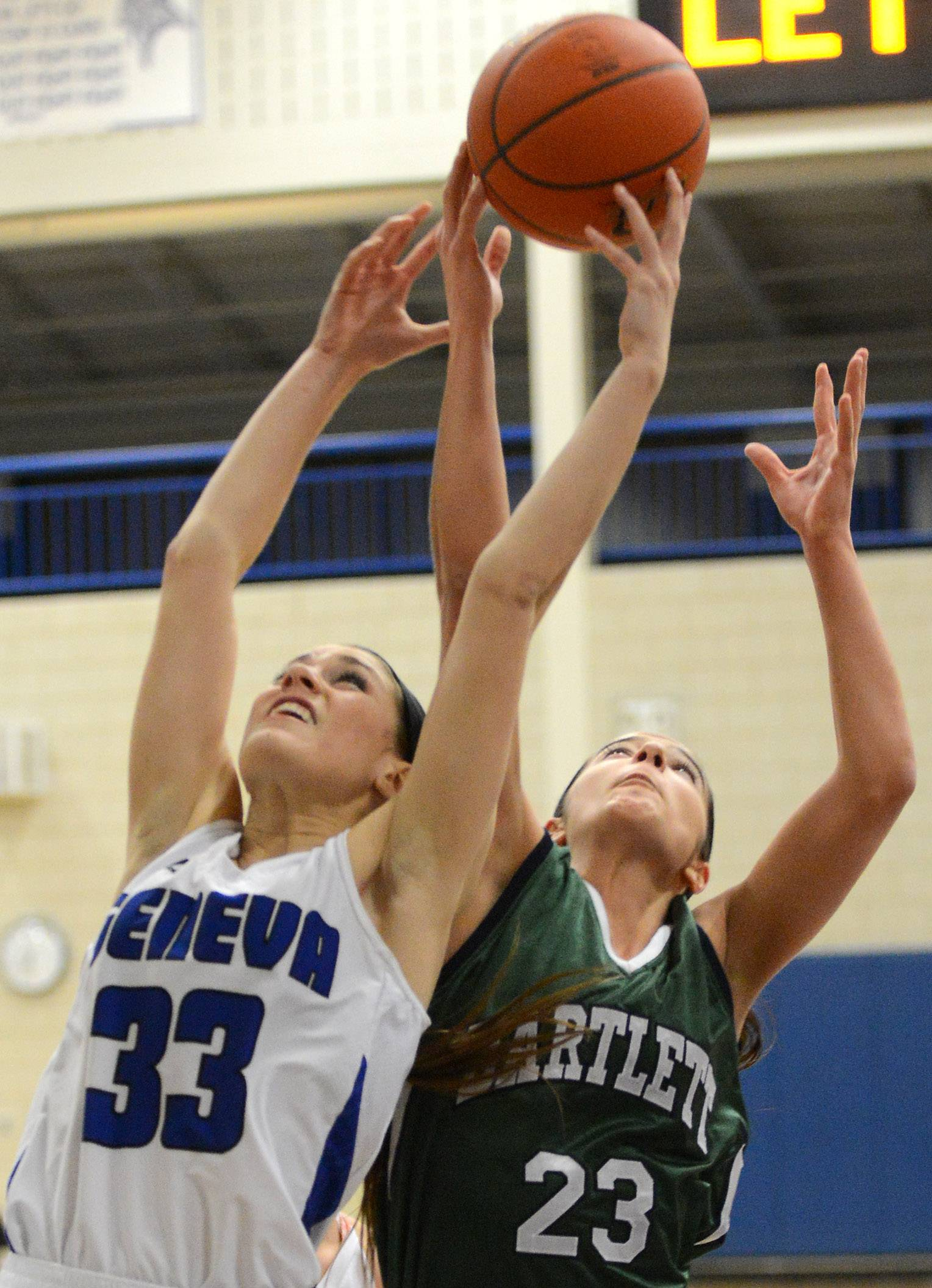 Geneva's Madeline Dunn (33) battles Bartlett for a rebound Thursday. The Vikings will be trying to win their sixth straight regional championship next week.