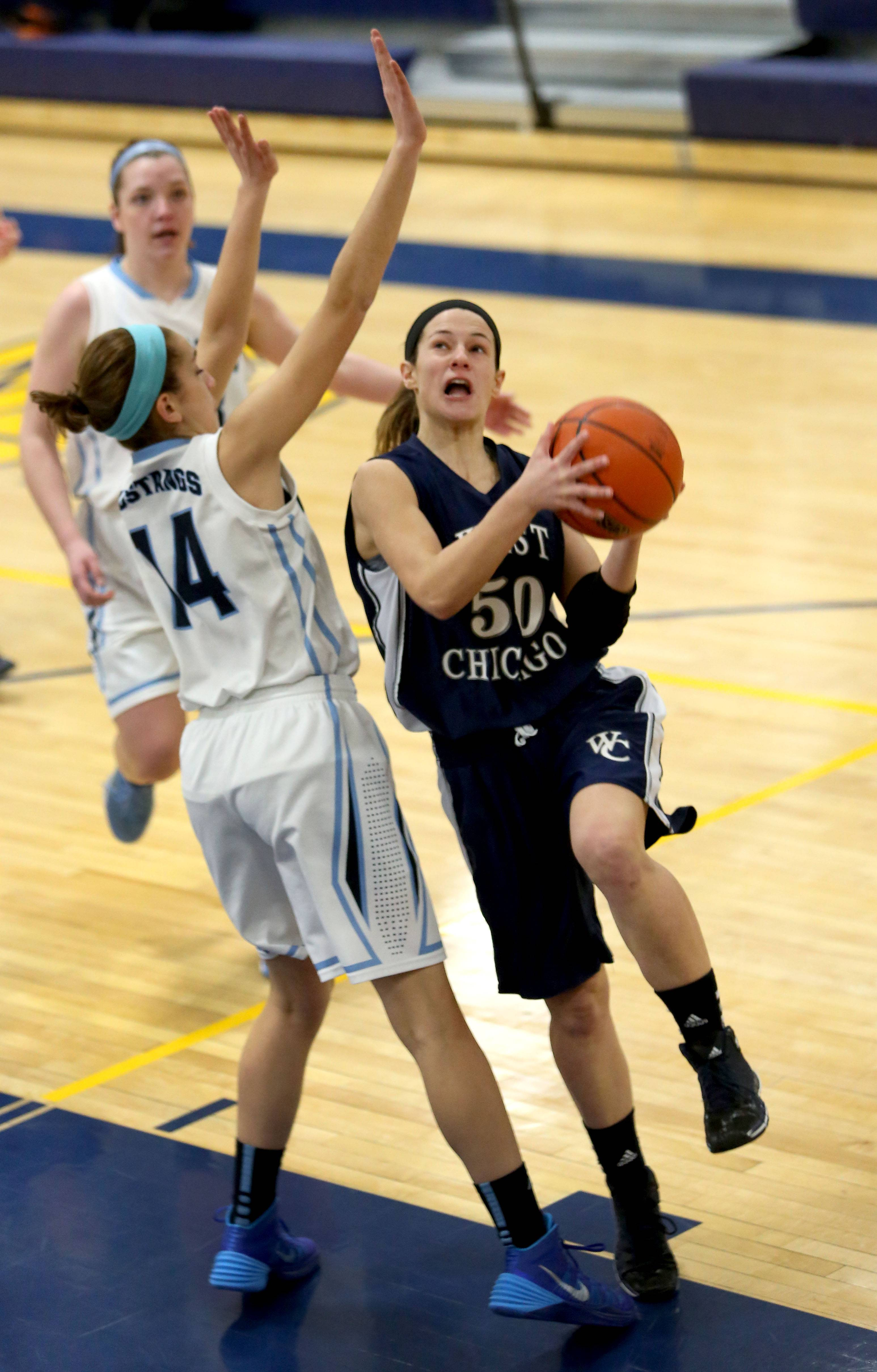 West Chicago's Natalie Warkins, right, looks to shoot around Claire Hardy of Downers Grove South.