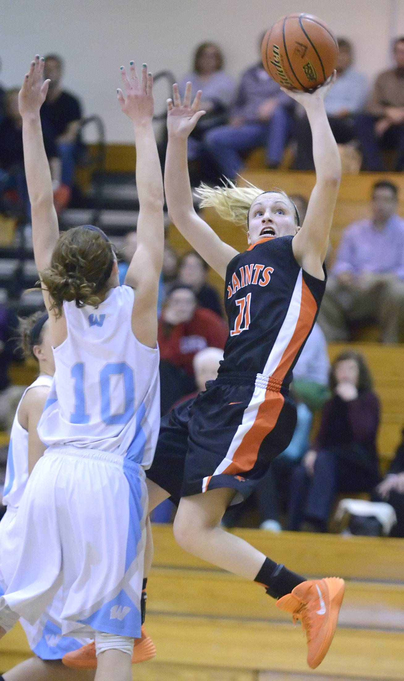 St. Charles East's Katelyn Claussner shoots over a block by Willowbrook's Molly Krawczykowski in the second quarter on Tuesday, February 18.