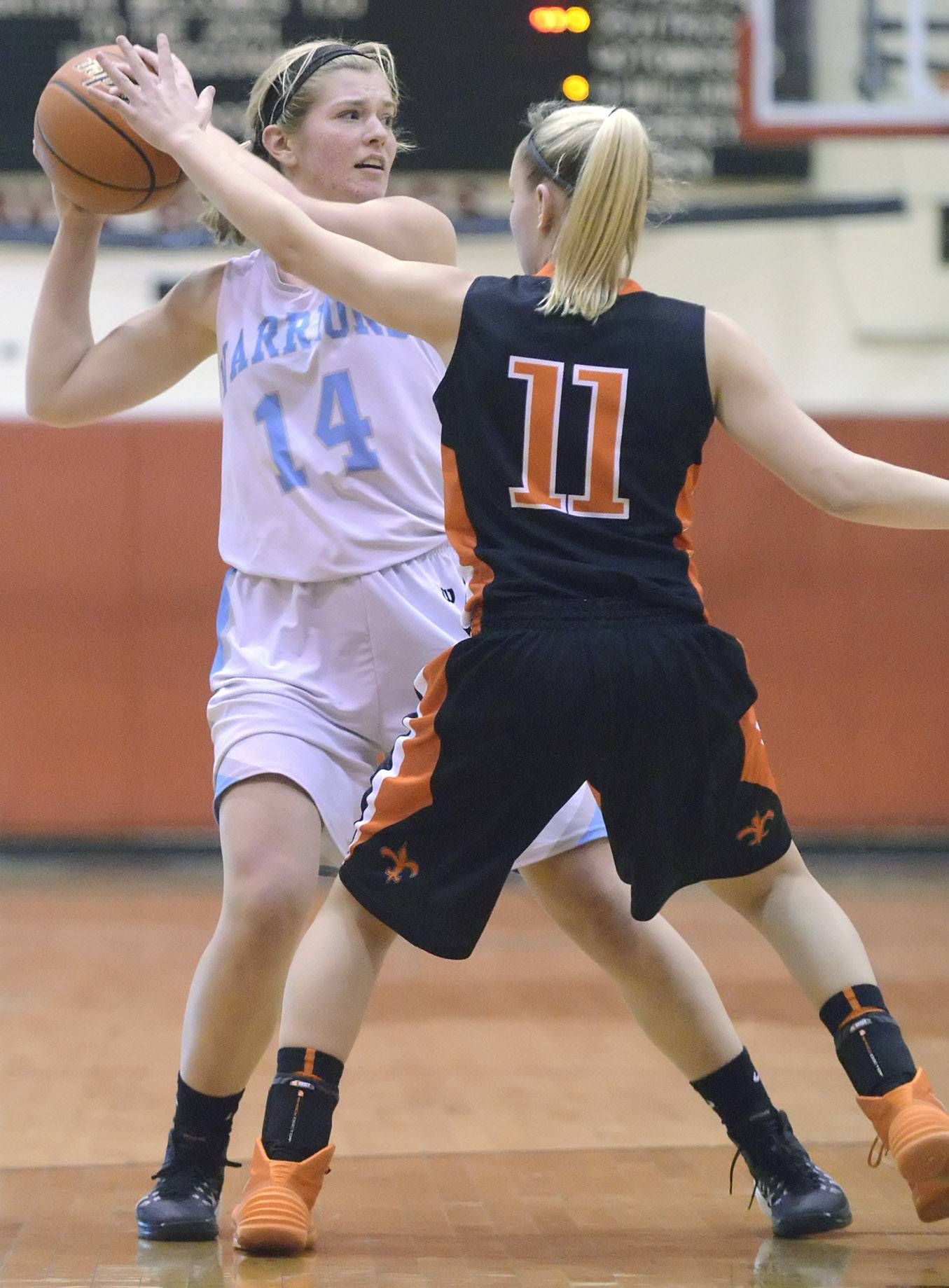 Willowbrook's Lauren Carroll looks to pass around St. Charles East's Katelyn Claussner in the third quarter on Tuesday, February 18.