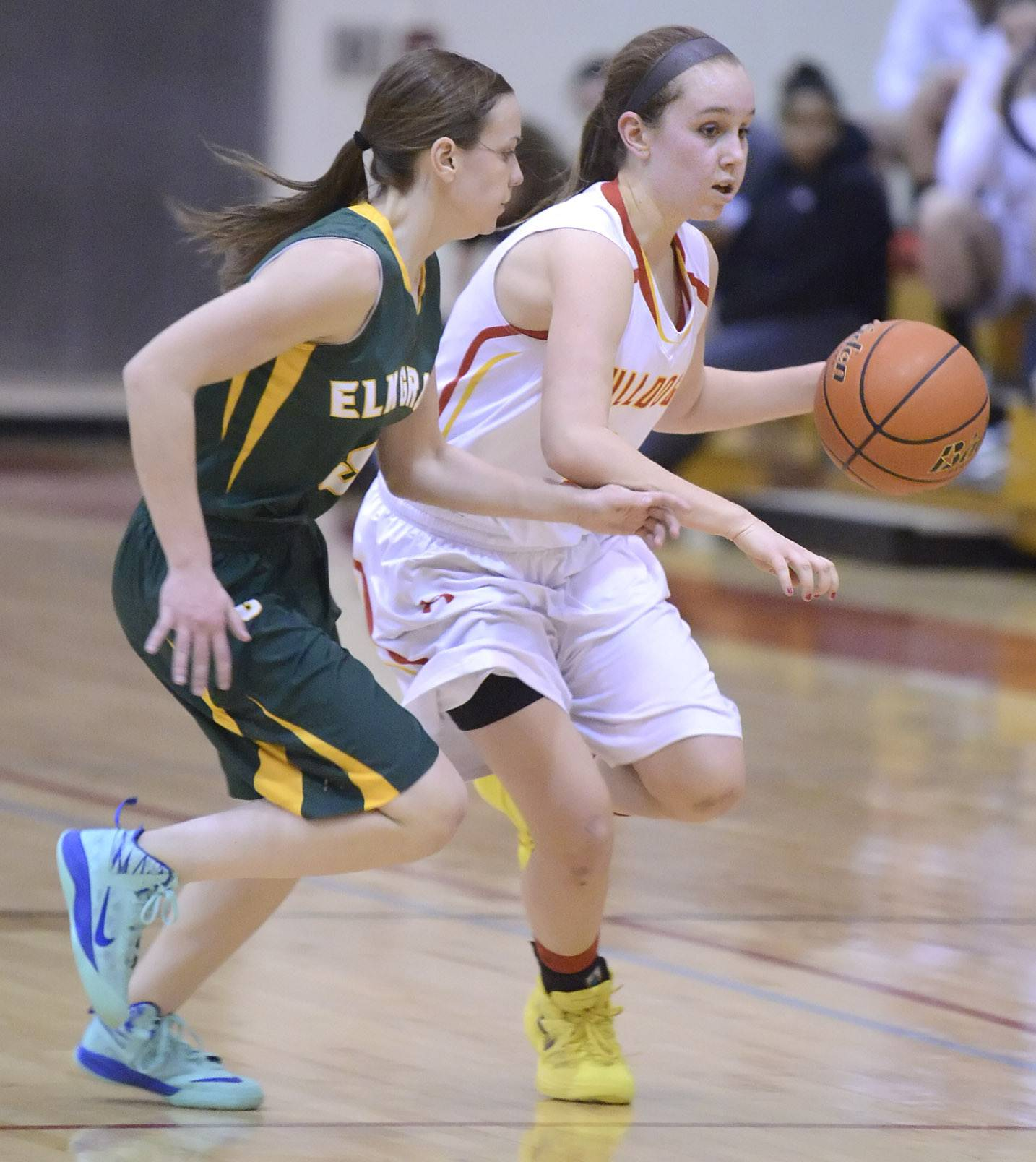 Batavia's Bethany Orman dribbles past Elk Grove's Abbey Sloan in the fourth quarter on Tuesday, February 18.