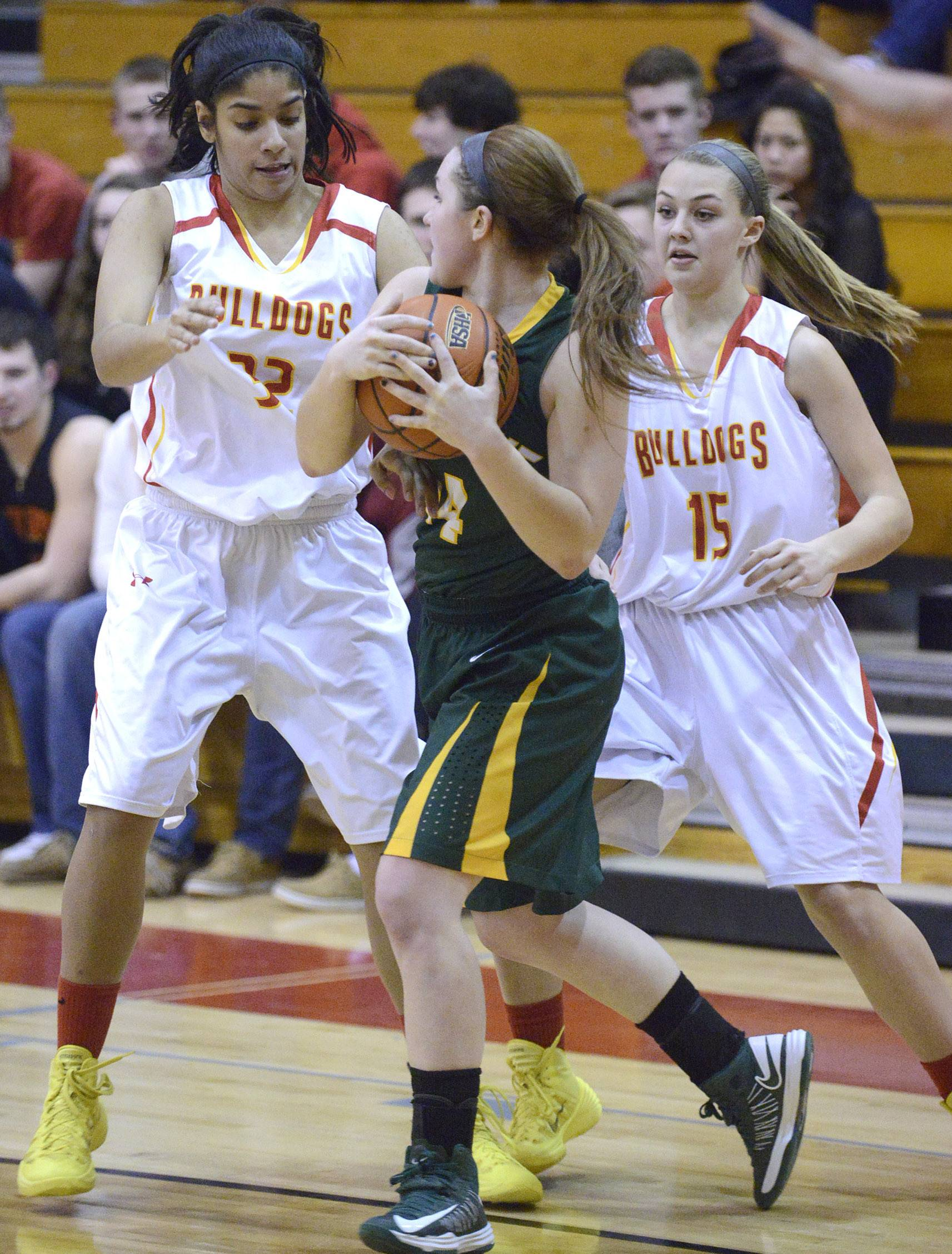 Batavia's Ana Marchiori, left, and Katie Weber, right surround Elk Grove's Taylor Brown on Tuesday in Batavia.
