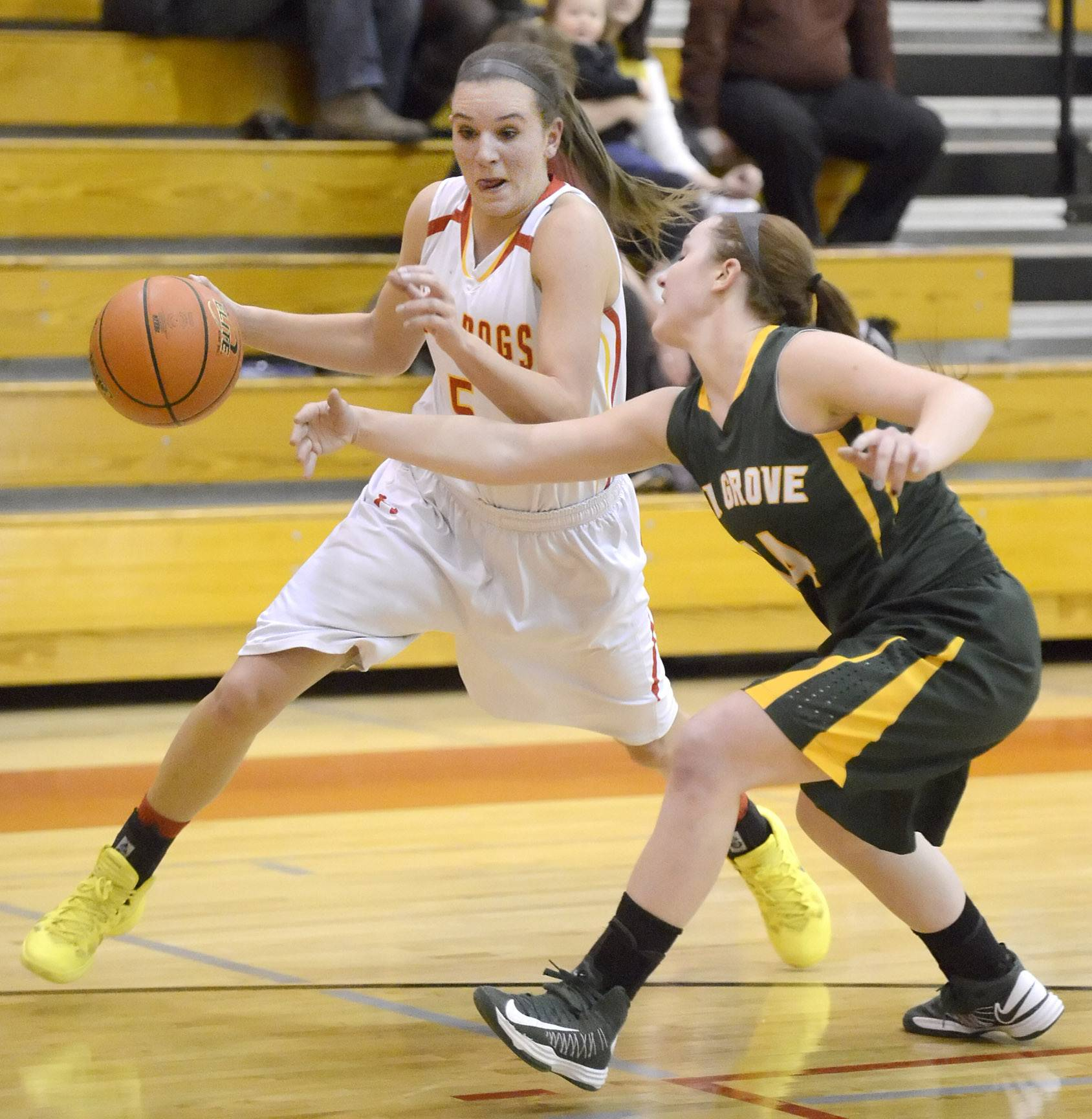 Batavia's Liza Fruendt dribbles around Elk Grove's Taylor Brown in the first quarter on Tuesday, February 18.