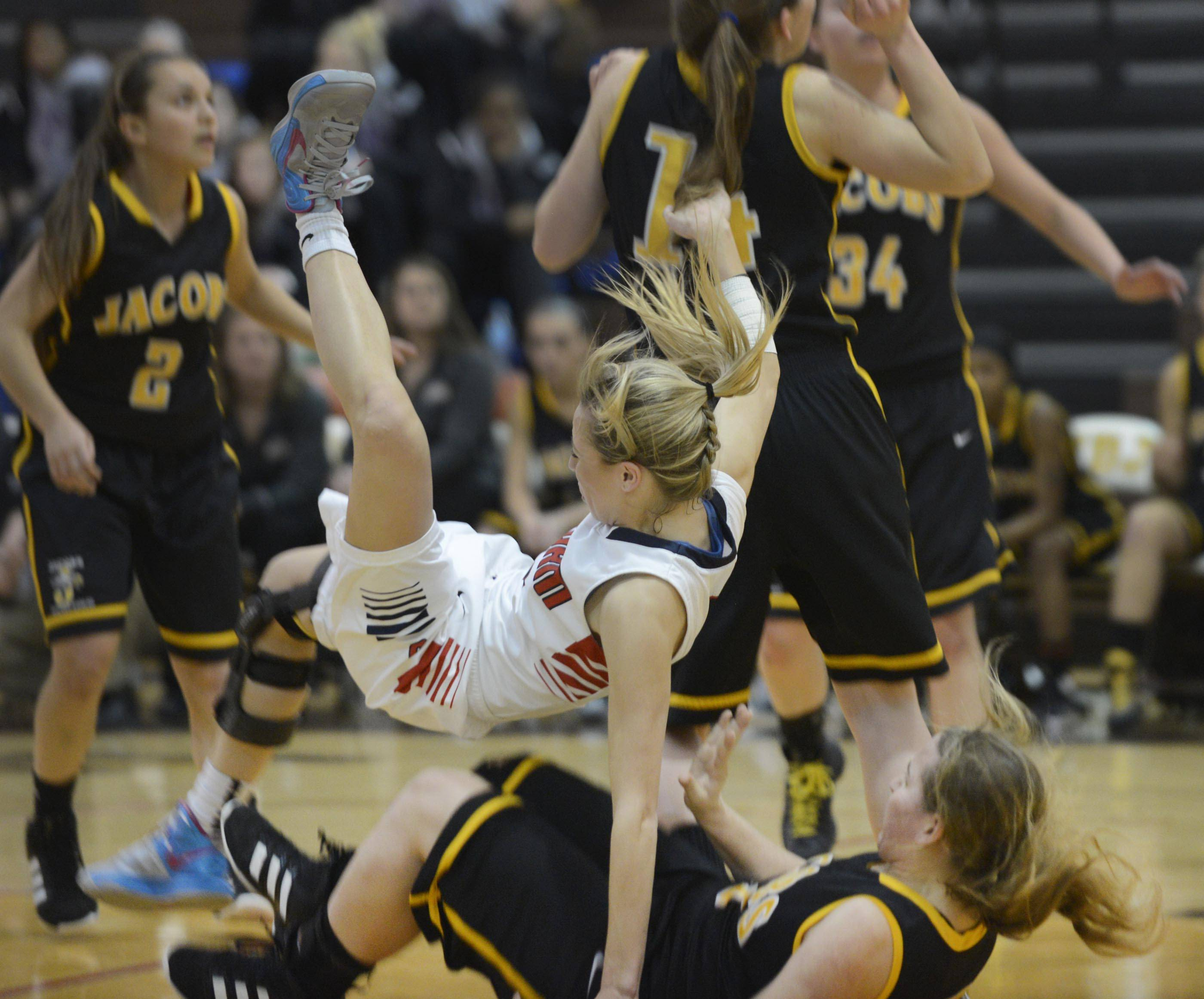 South Elgin's Savanah Uveges falls on Jacobs' Alyssa Lach Tuesday in a regional semifinal game in Algonquin. Neither player was injured.