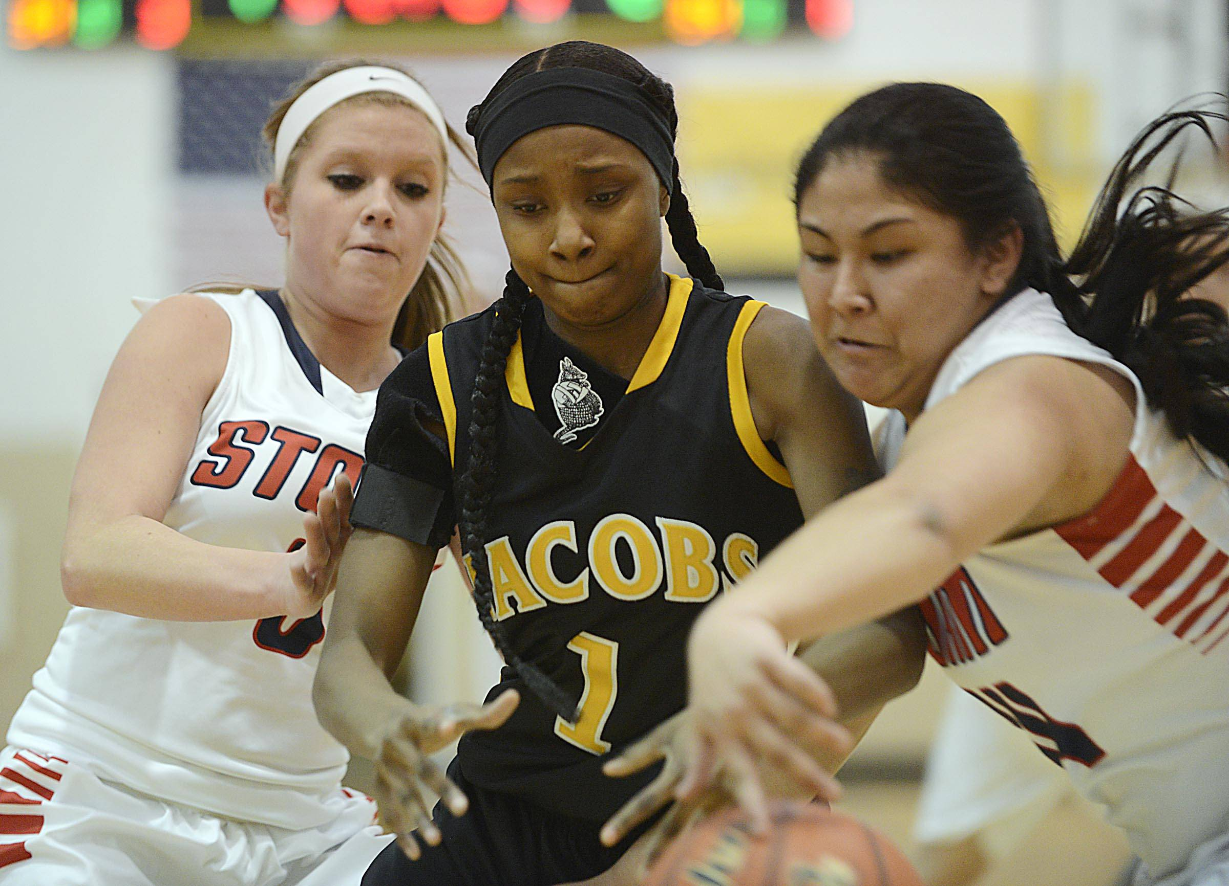 South Elgin's Nadia Yang steals a pass for Jacobs' Glenita Williams Tuesday in a Regional semifinal game in Algonquin. At left is South Elgin's Mackie Kelleher.