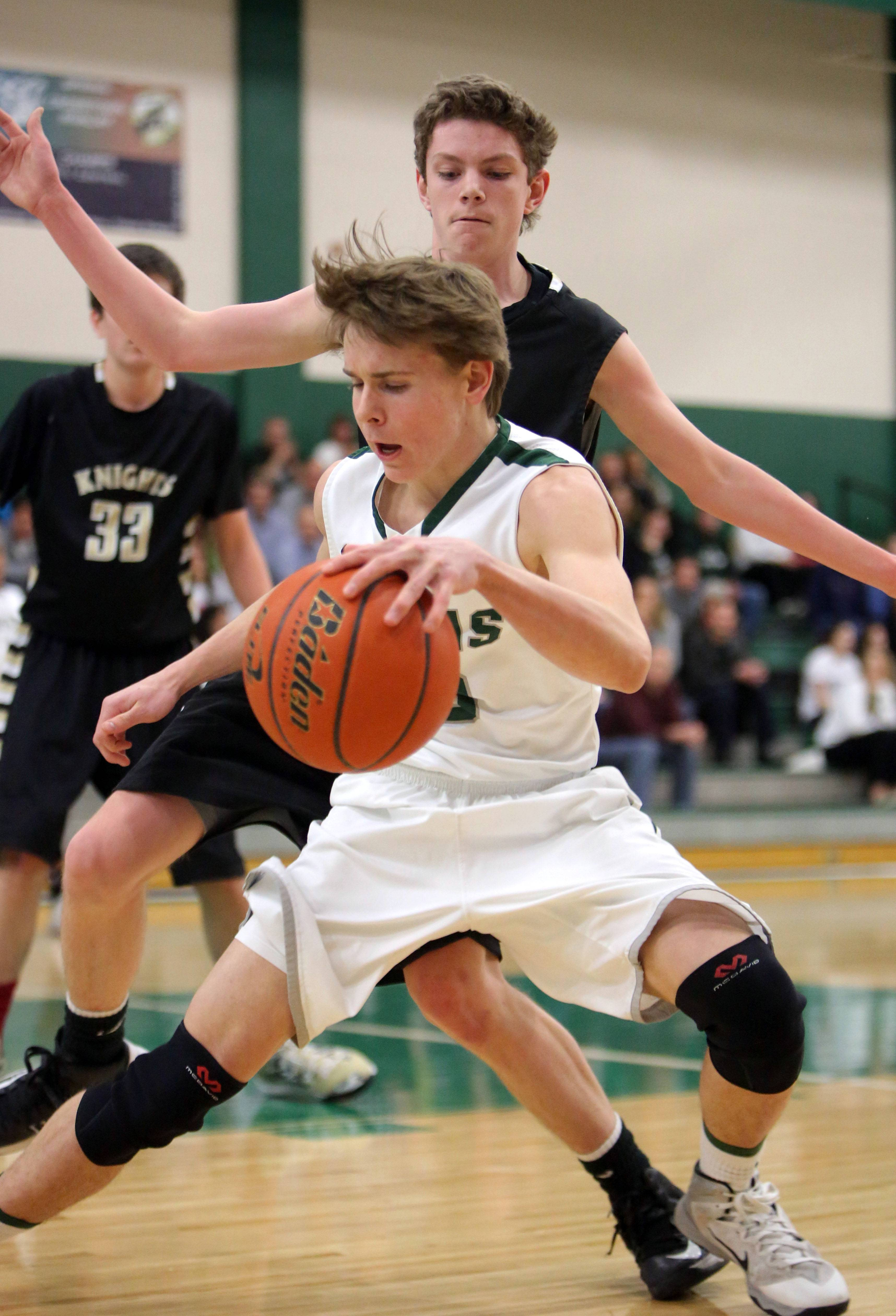 Grayslake Central's Michael Benko, front, tries to escape from Grayslake North's Lucas Buckels on Tuesday night at Grayslake Central.