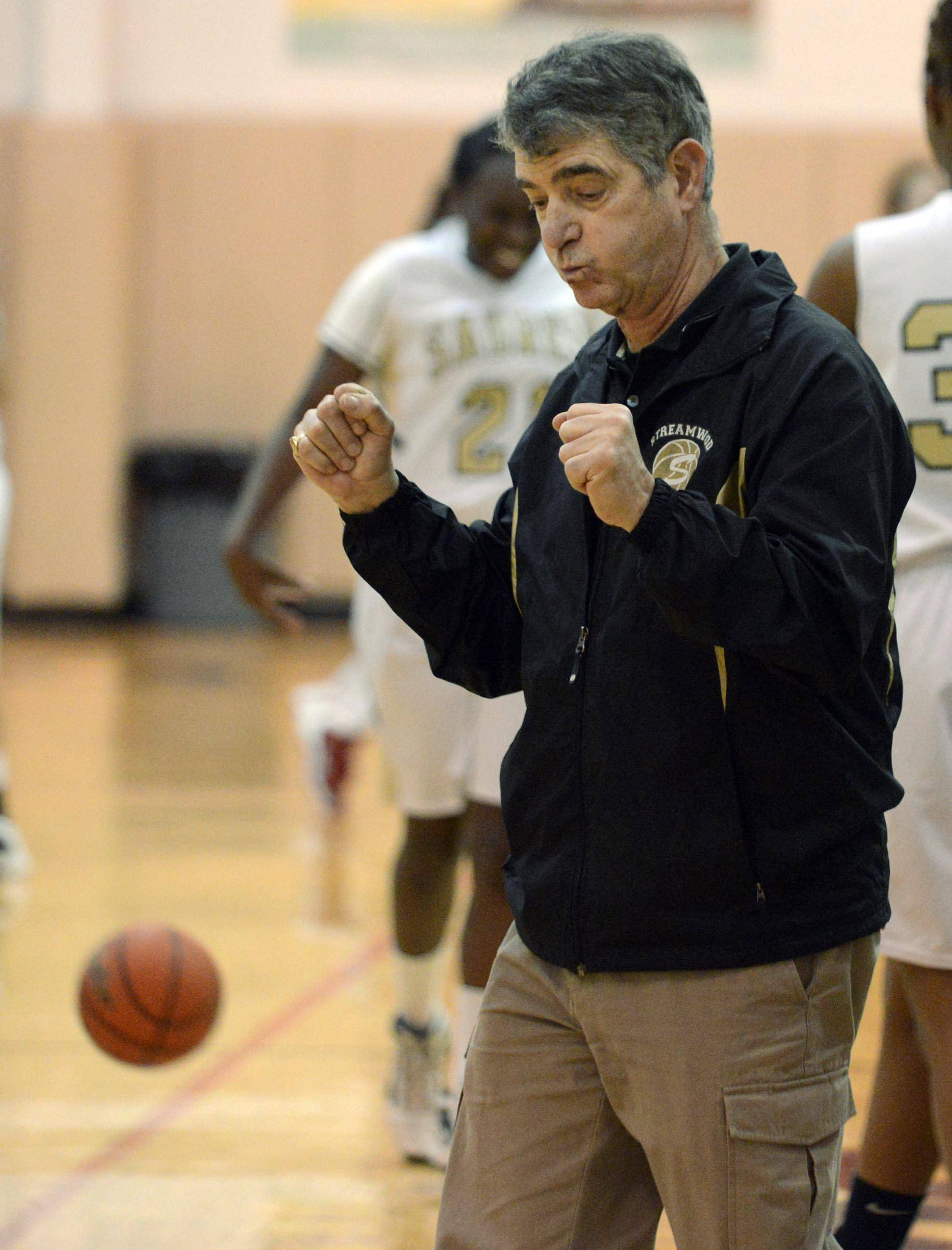 Streamwood head coach George Rosner reacts as he gets his 400th win Tuesday in a regional semifinal game against Dundee-Crown in Algonquin.