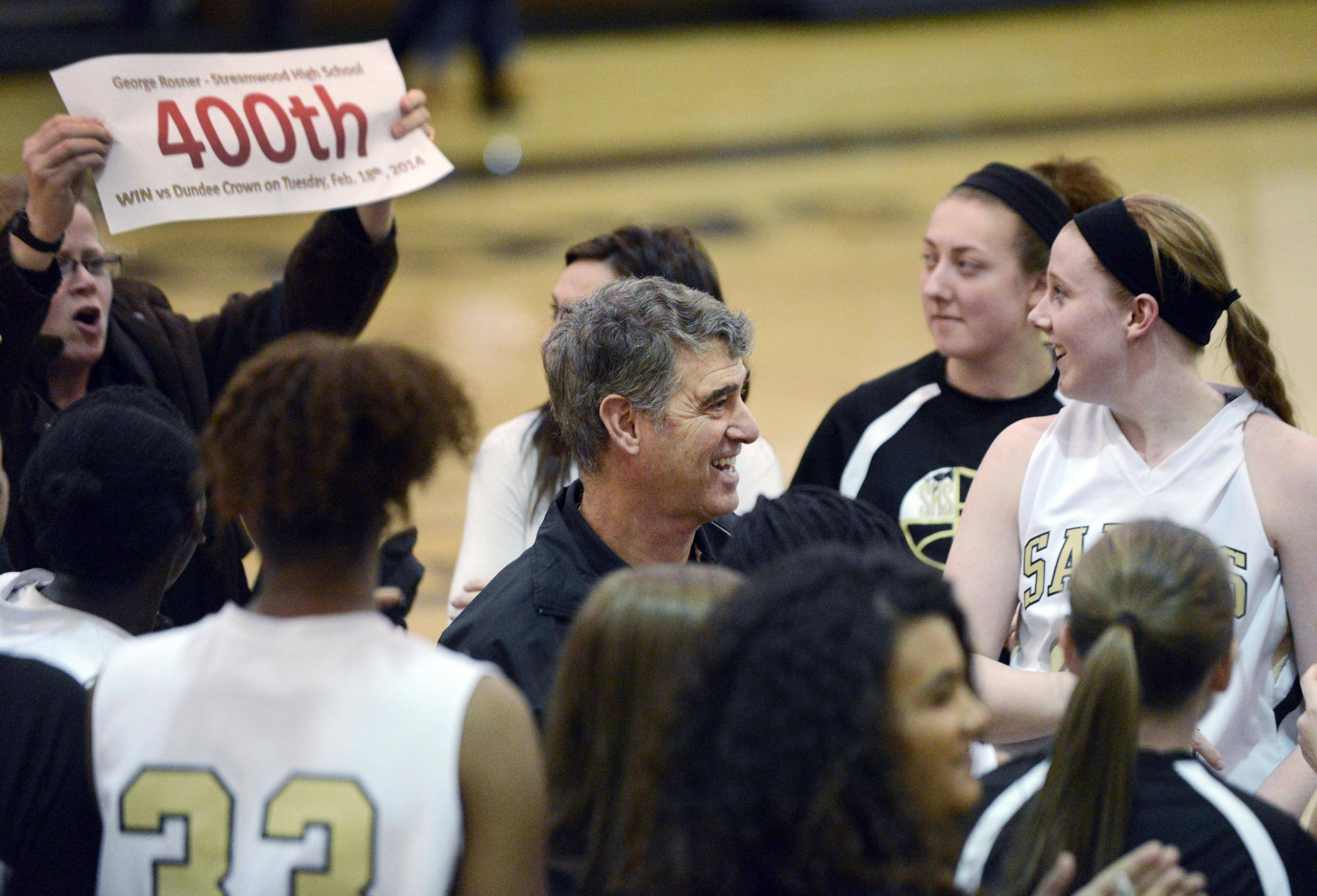 Streamwood head coach George Rosner smiles with his team after they defeated Dundee-Crown Tuesday in a regional semifinal game in Algonquin. It was his 400th career win.