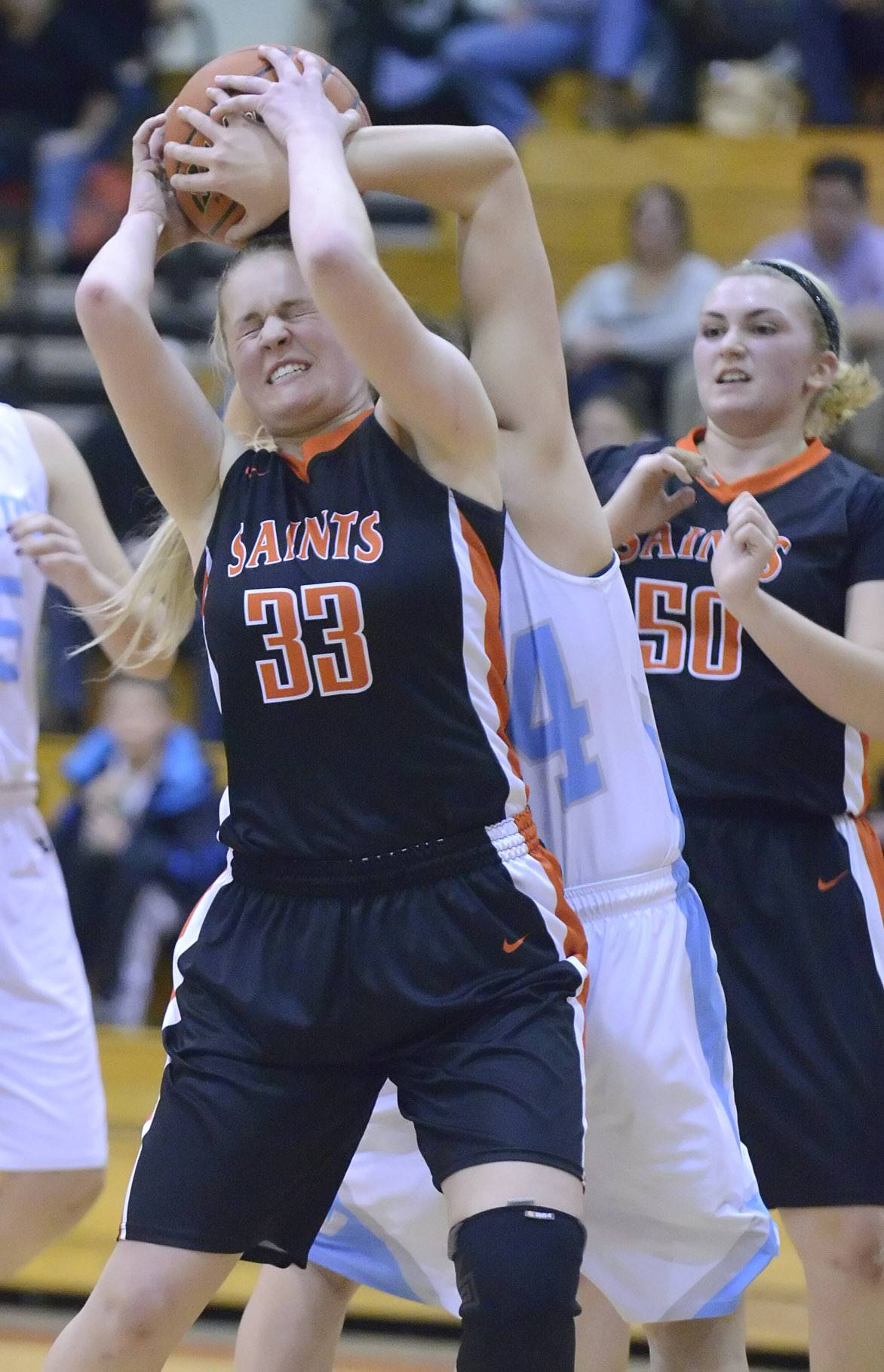 St. Charles East's Hannah Nowling and Willowbrook's Alyssa Ressinger wrestle for a rebound in the second quarter .