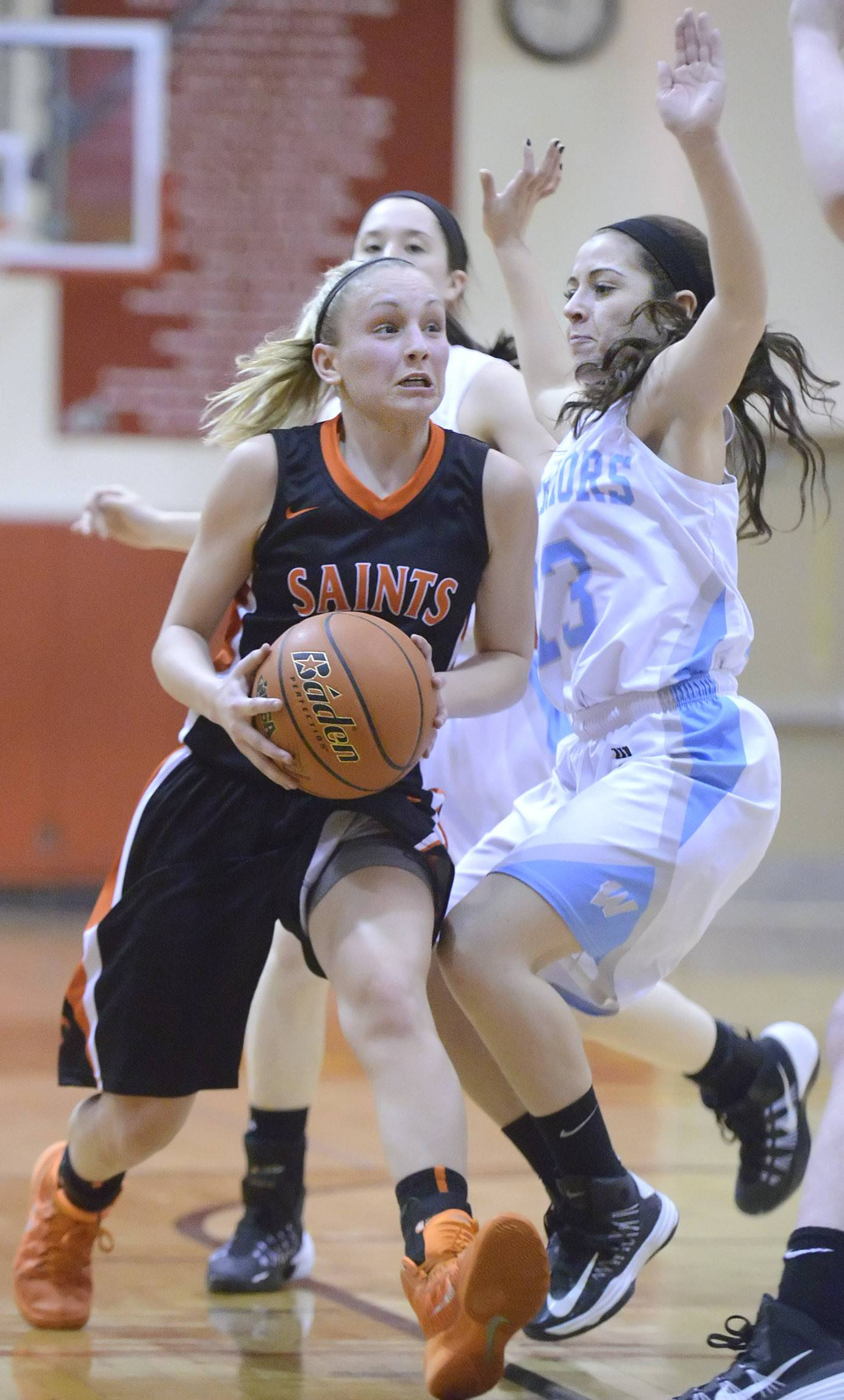 St. Charles East's Katelyn Claussner maneuvers her way around Willowbrook's Allison Torres in the second quarter .