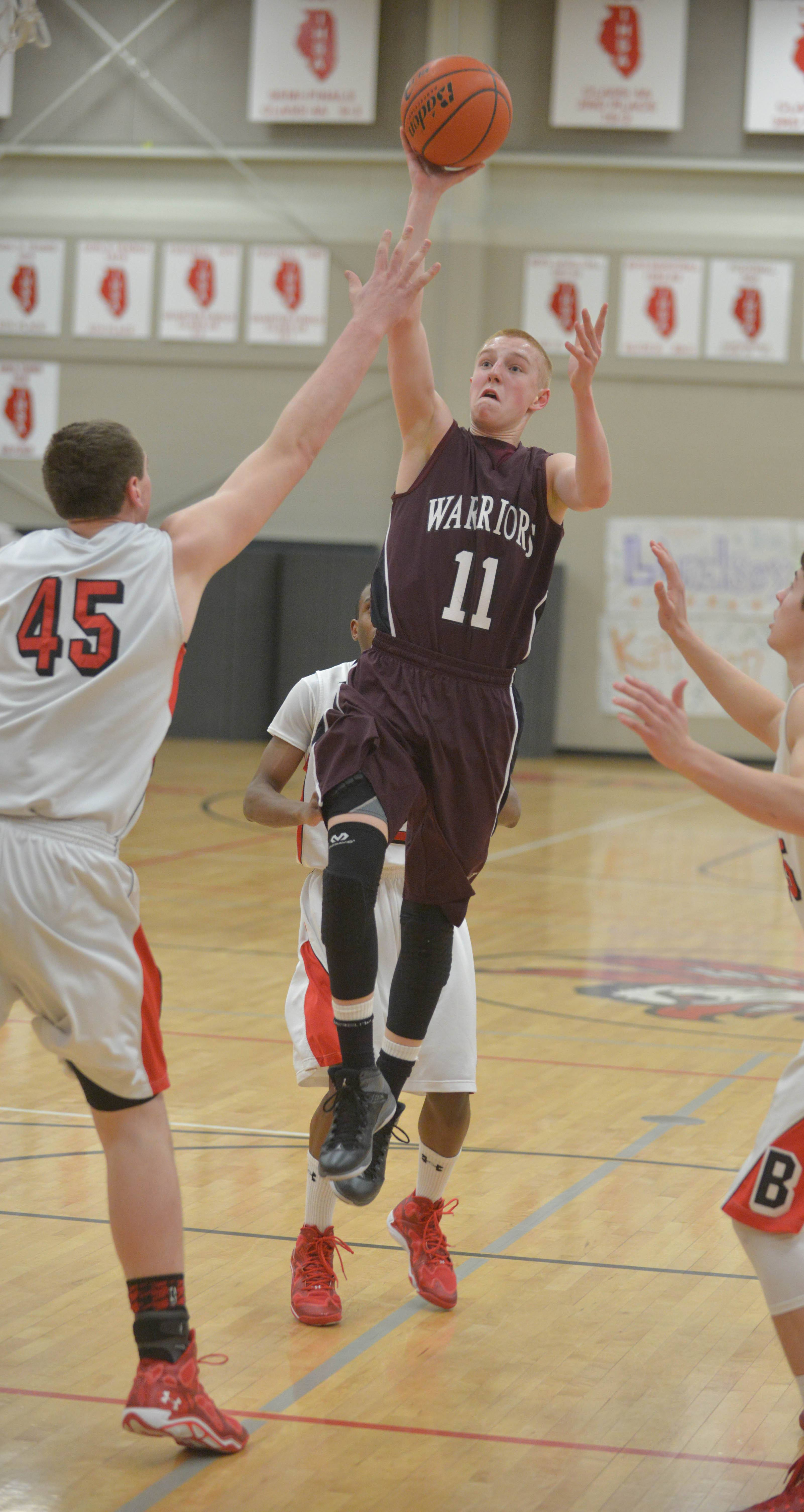 Josh Ruggles of Wheaton Academy takes a shot.