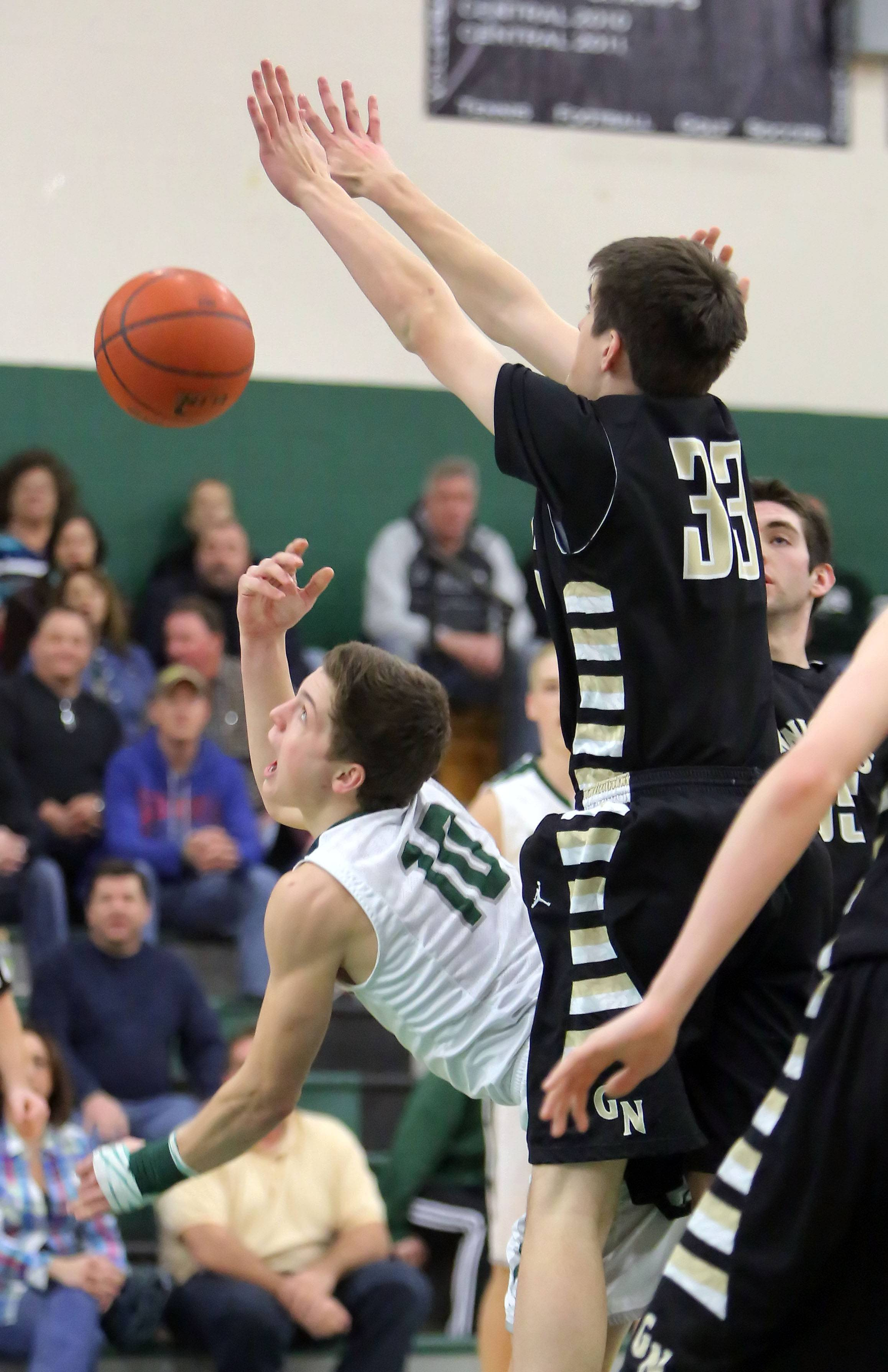 Grayslake Central's Joey Mudd, left, scoops a shot past Grayslake North's Aiden Einloth.