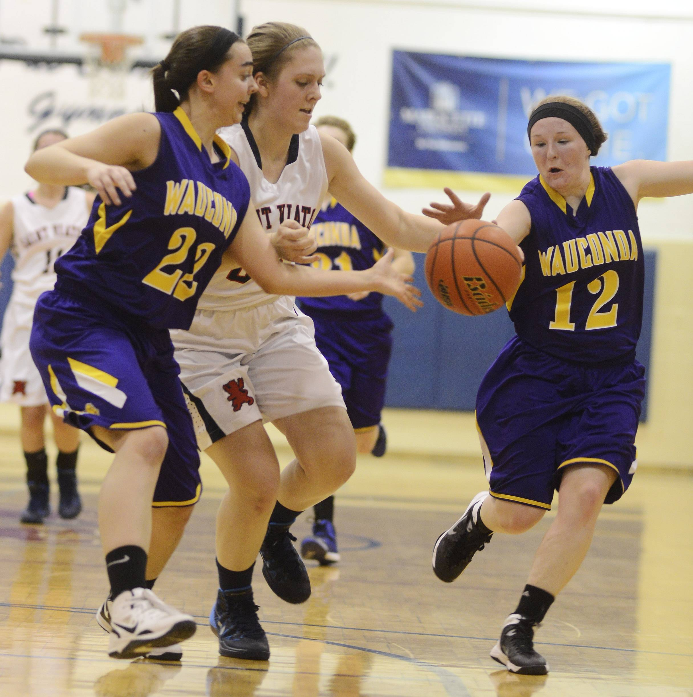 Wauconda defenders Natalie Harding, left, and Lauren Nee try to steal the ball from St. Viator's Jessica Hohlweg during Wednesday's game in Arlington Heights.