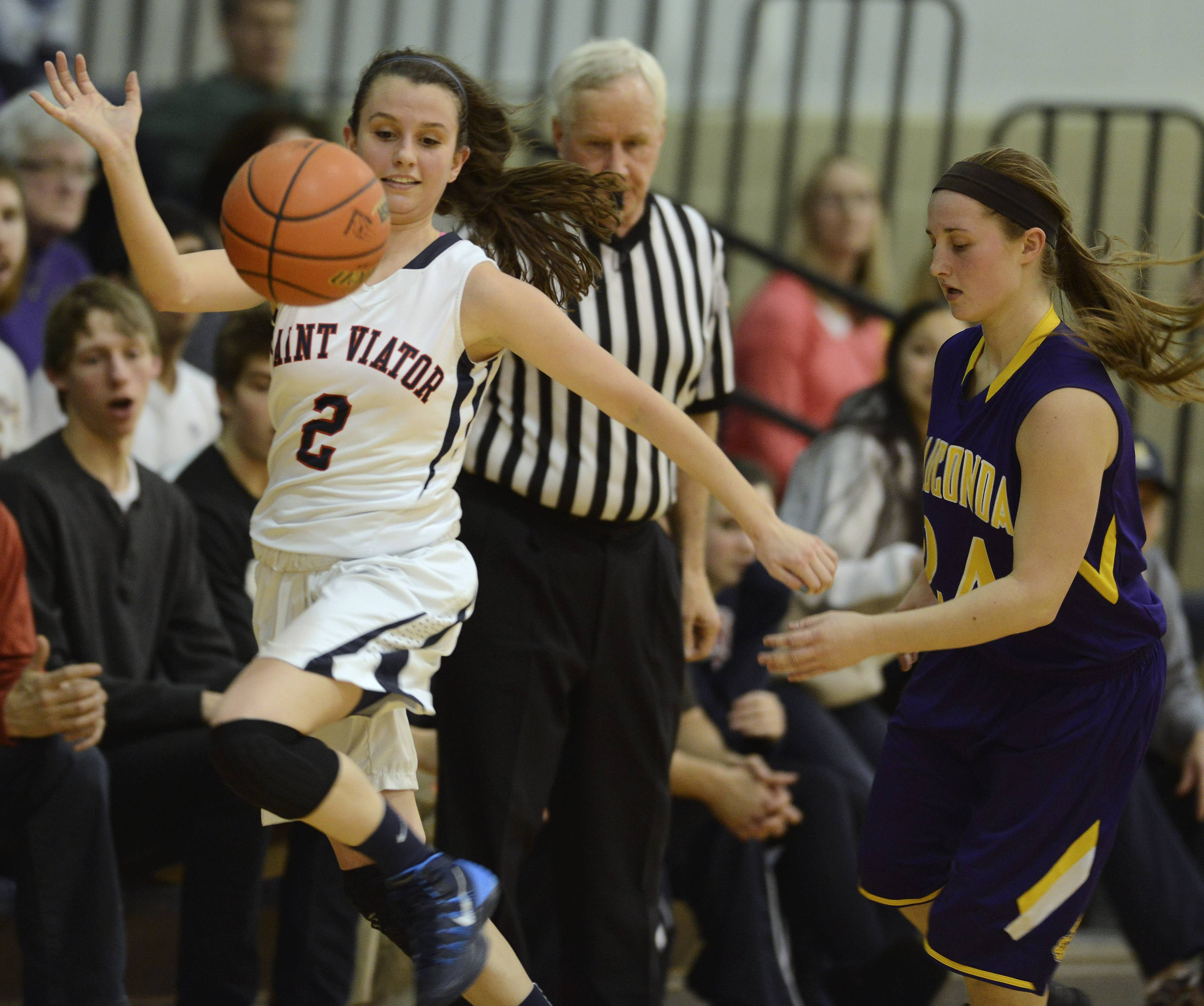 St. Viator's Susie Moynihan, left, tries to stay in bounds while attempting to steal the ball from Wauconda's Anna Wisniewski during Wednesday's game in Arlington Heights.