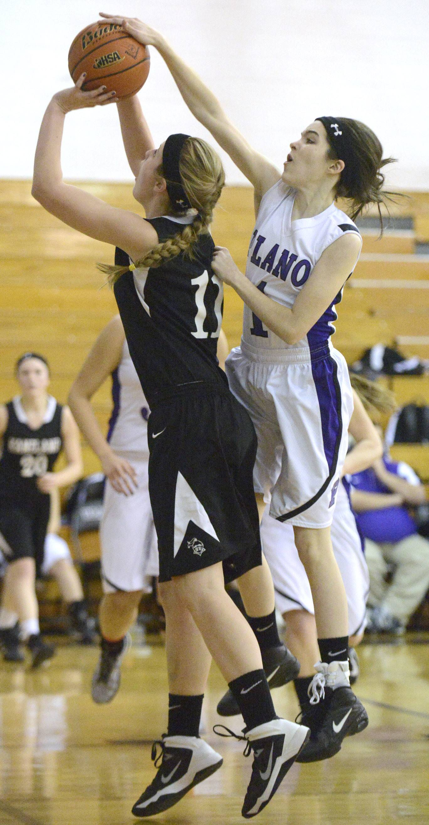 Kaneland's Ally VanBogaert is denied a shot by Plano's Jackie Schane in the second quarter of the Class 3A regional meet on Wednesday, February 19.
