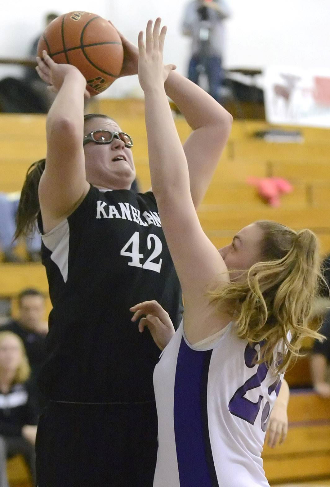 Kaneland's Kelly Wallner shoots over a block by Plano's Hayley Beck in the first quarter of the Class 3A regional meet on Wednesday, February 19.