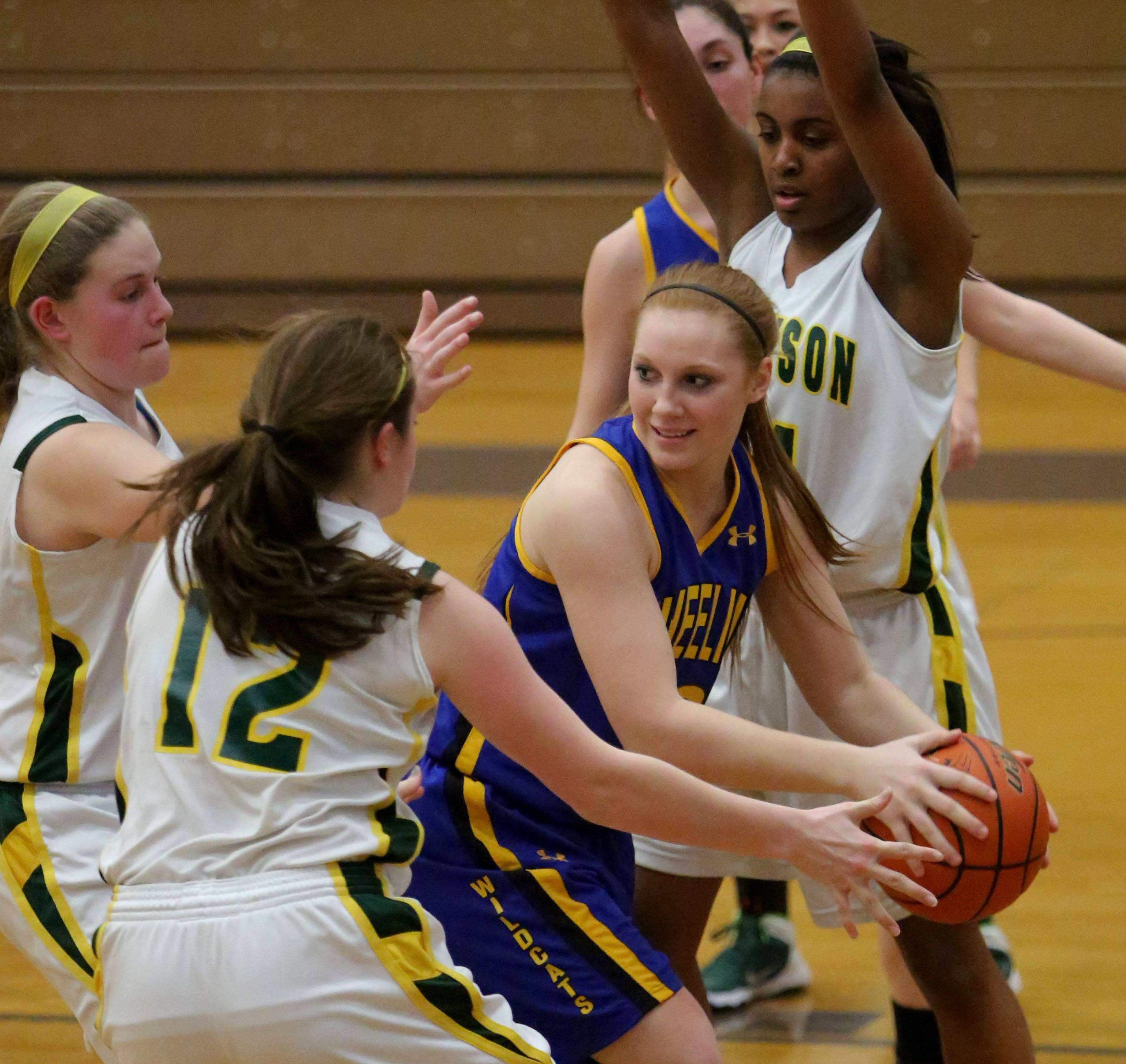 Wheeling's Michaela Vasey gets trapped by a host of Stevenson players during Class 4A regional semifinal play at Waukegan on Wednesday.