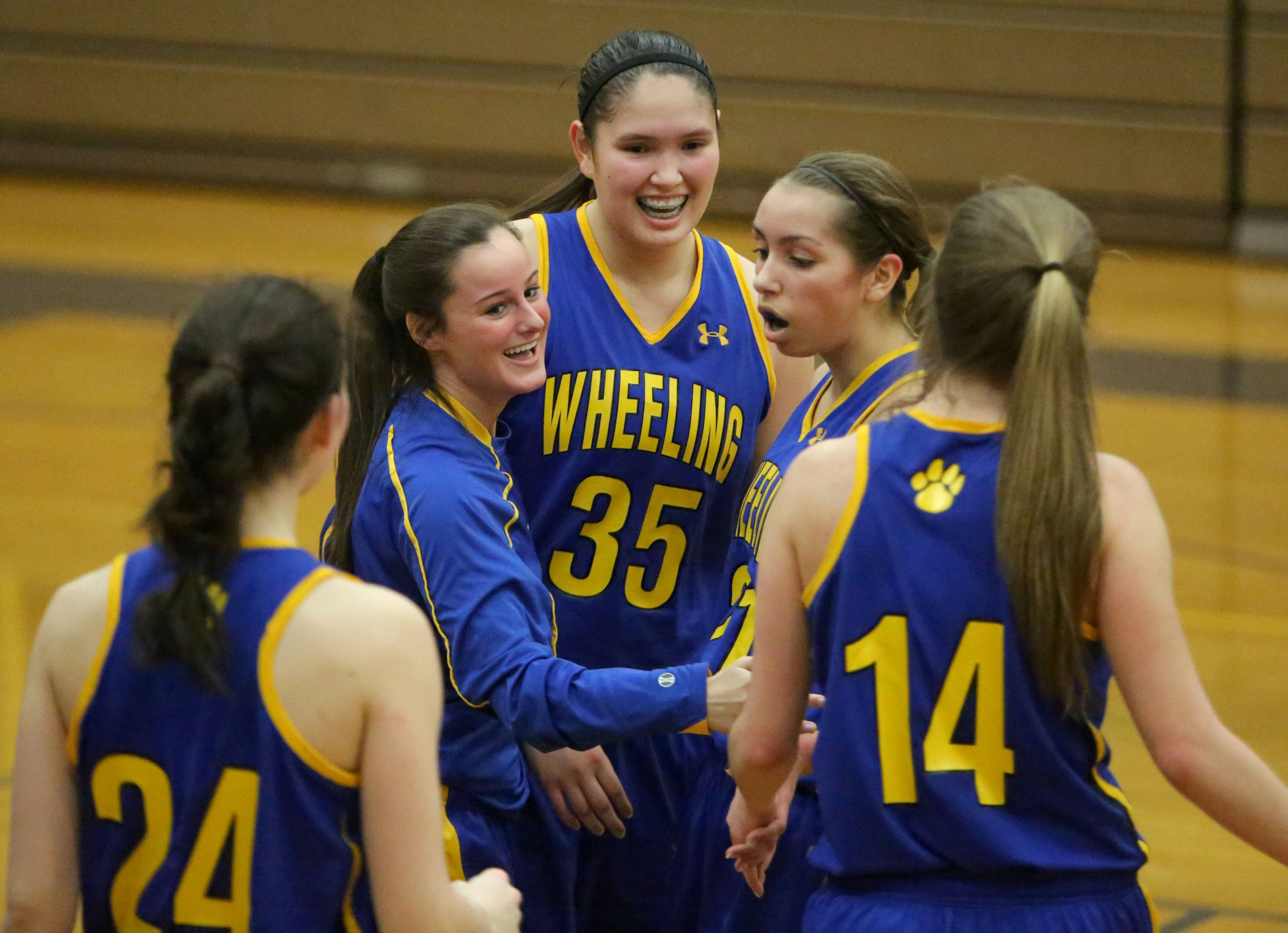 Wheeling teammates celebrate after beating Stevenson .