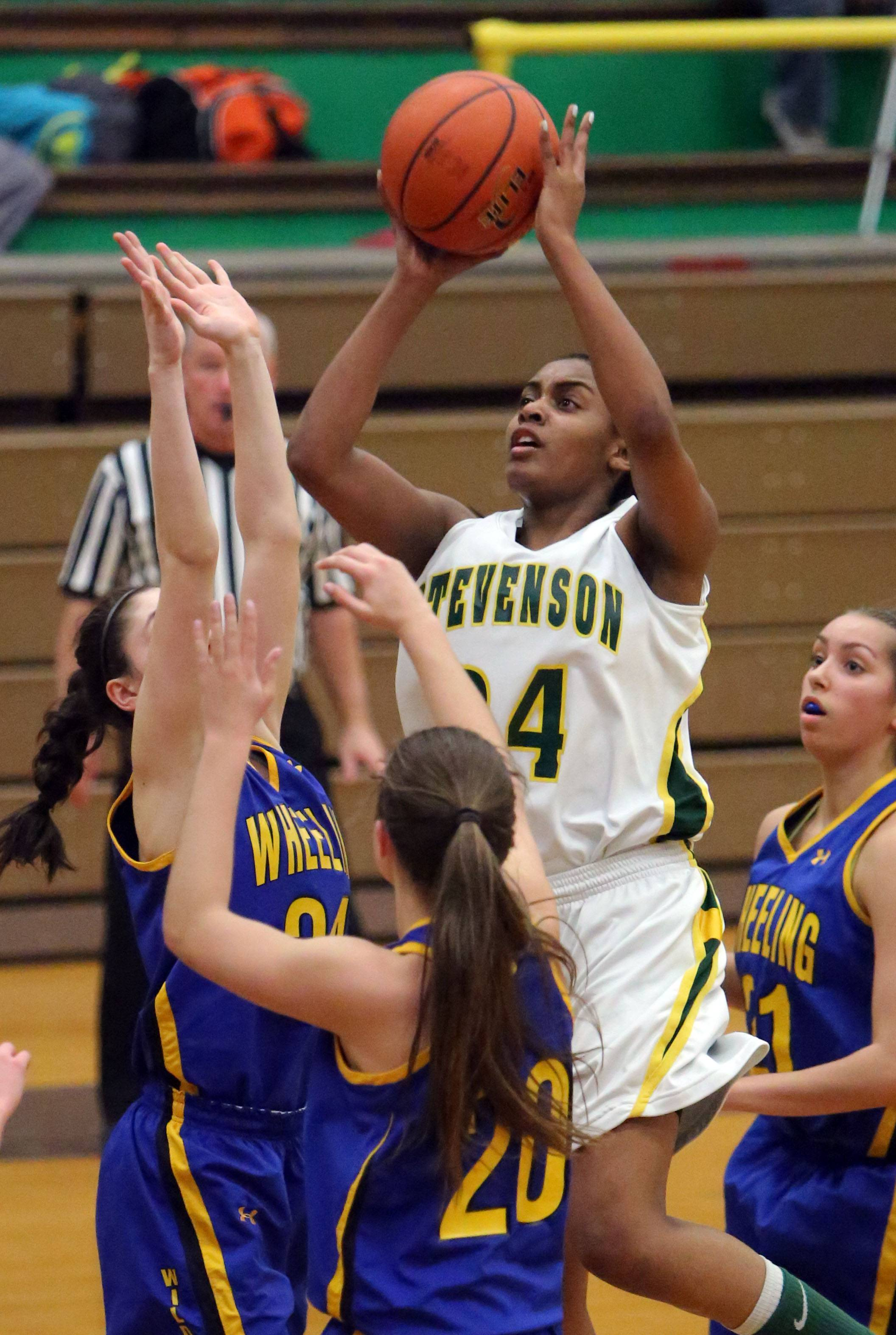 Stevenson's Taylor Buford, right, shoots over Wheeling's Melissa Claver and Elizabeth Smith.