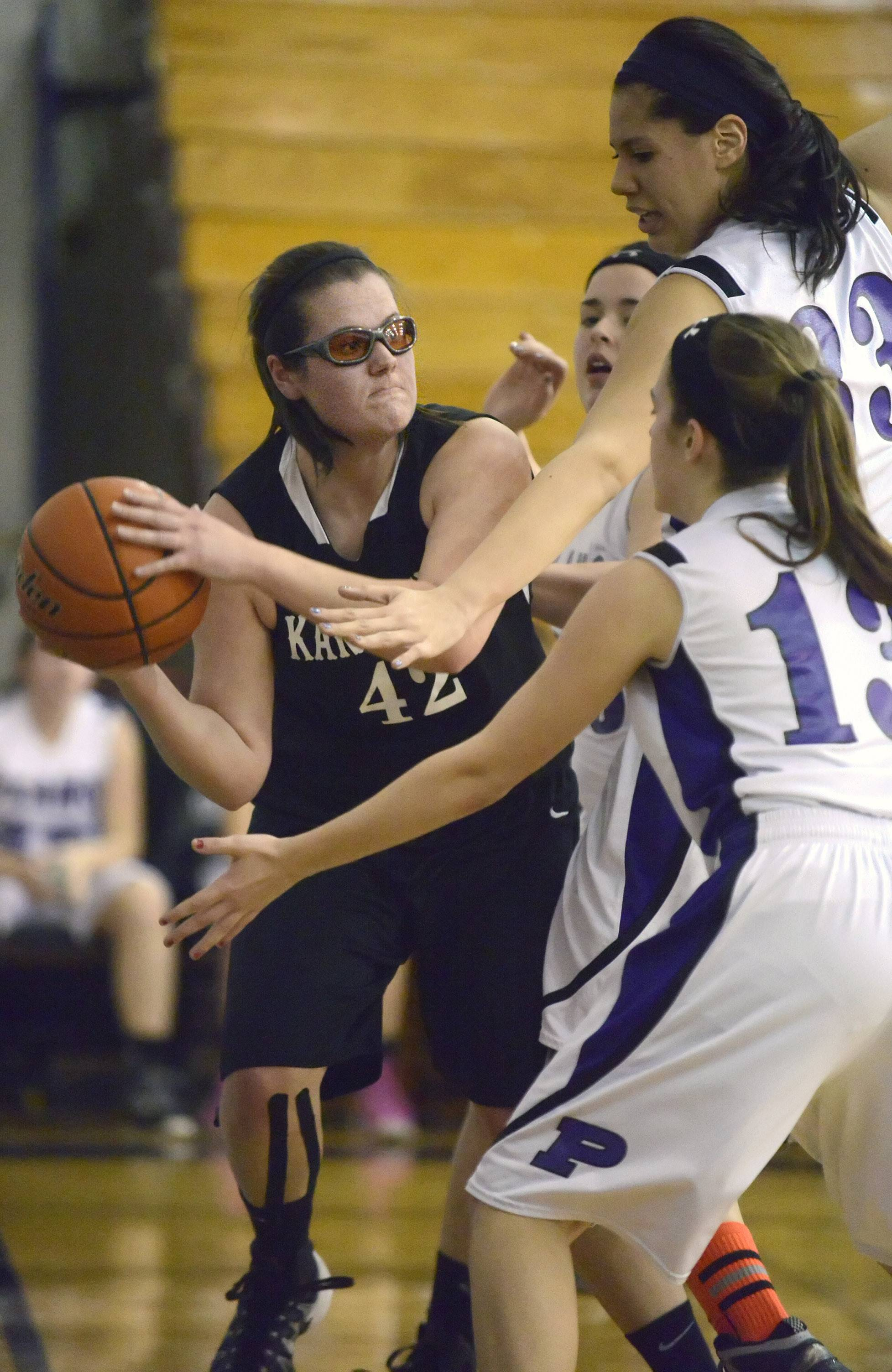 Kaneland's Kelly Wallner looks to pass around a block by Plano's Jewel Hupe and Clarisa Martinez in the second quarter.