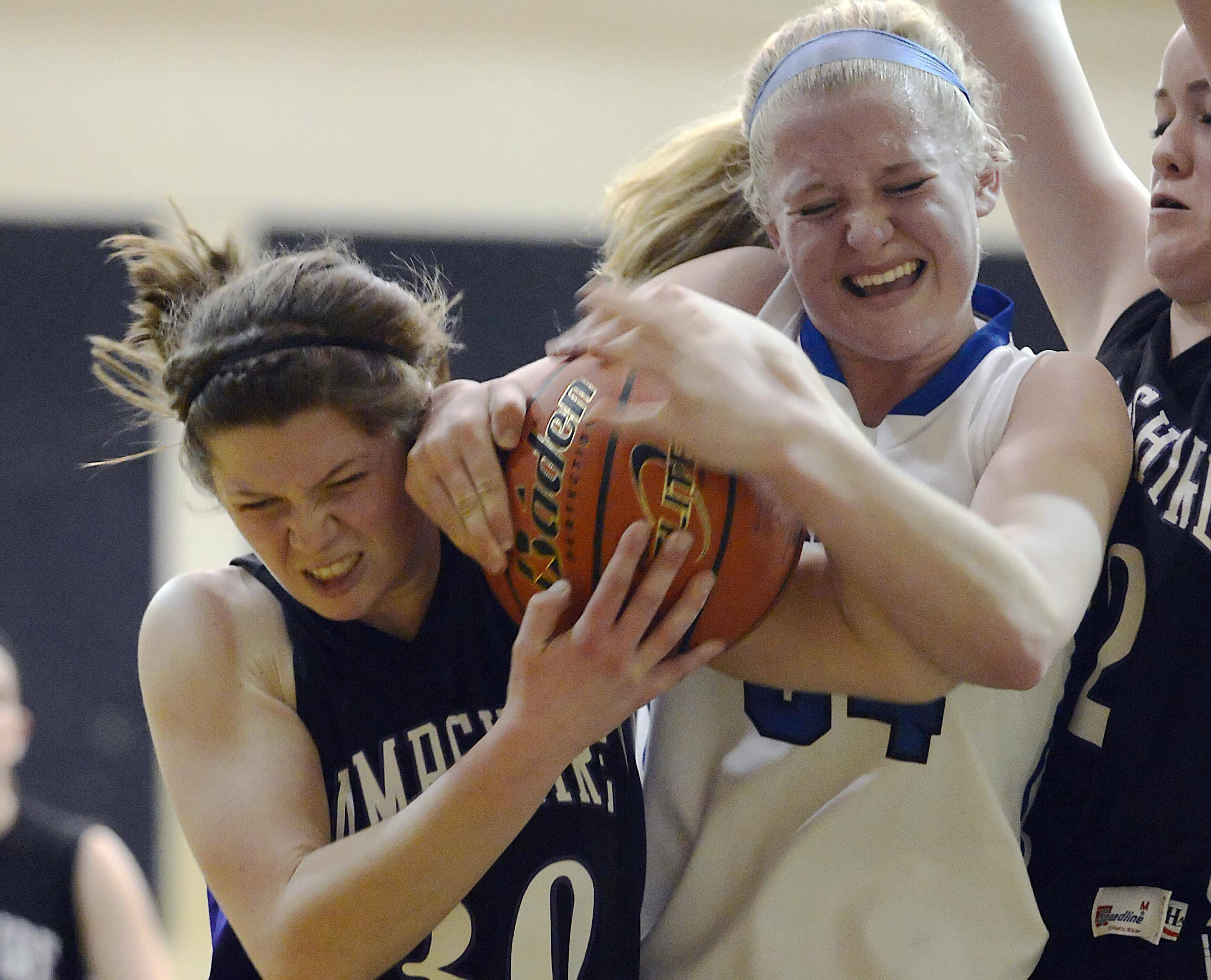 Burlington Central's Samantha Pryor and Hampshire's Tricia Dumoulin fight for the ball.
