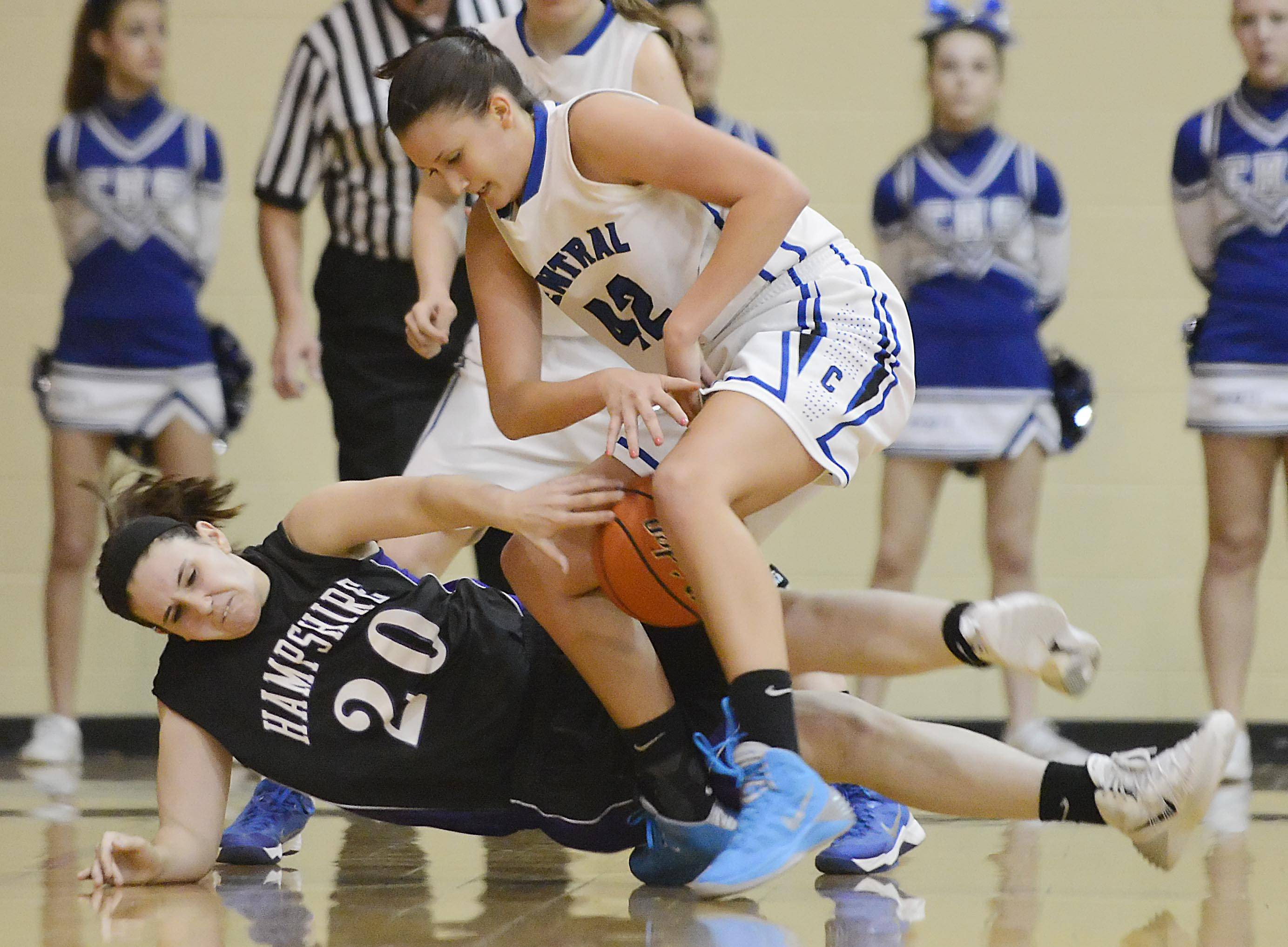 Burlington Central's Alison Colby loses the ball as Hampshire's Peyton DeChant falls while defending.