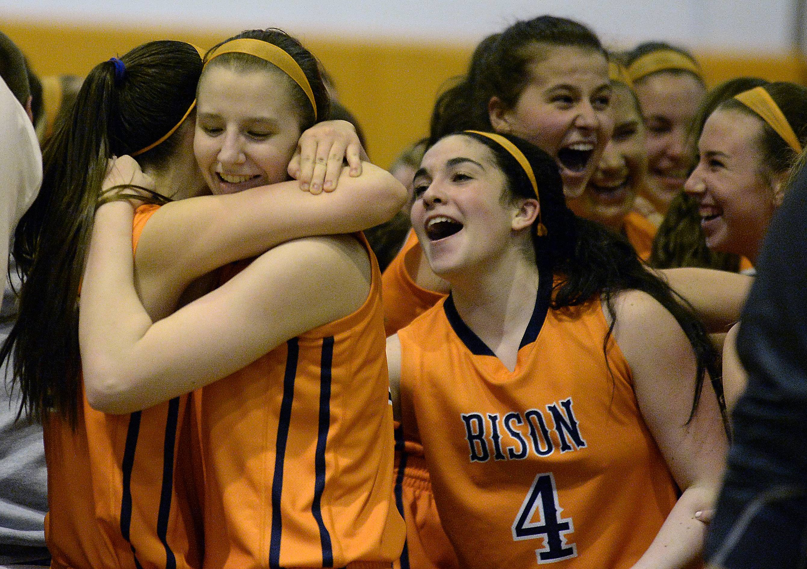 Buffalo Grove's Maddy Callahan, Maddie Welter and Julie Jambrone (4) celebrate their OT victory against Prospect in Class 4A regional championship action Thursday at Buffalo Grove.