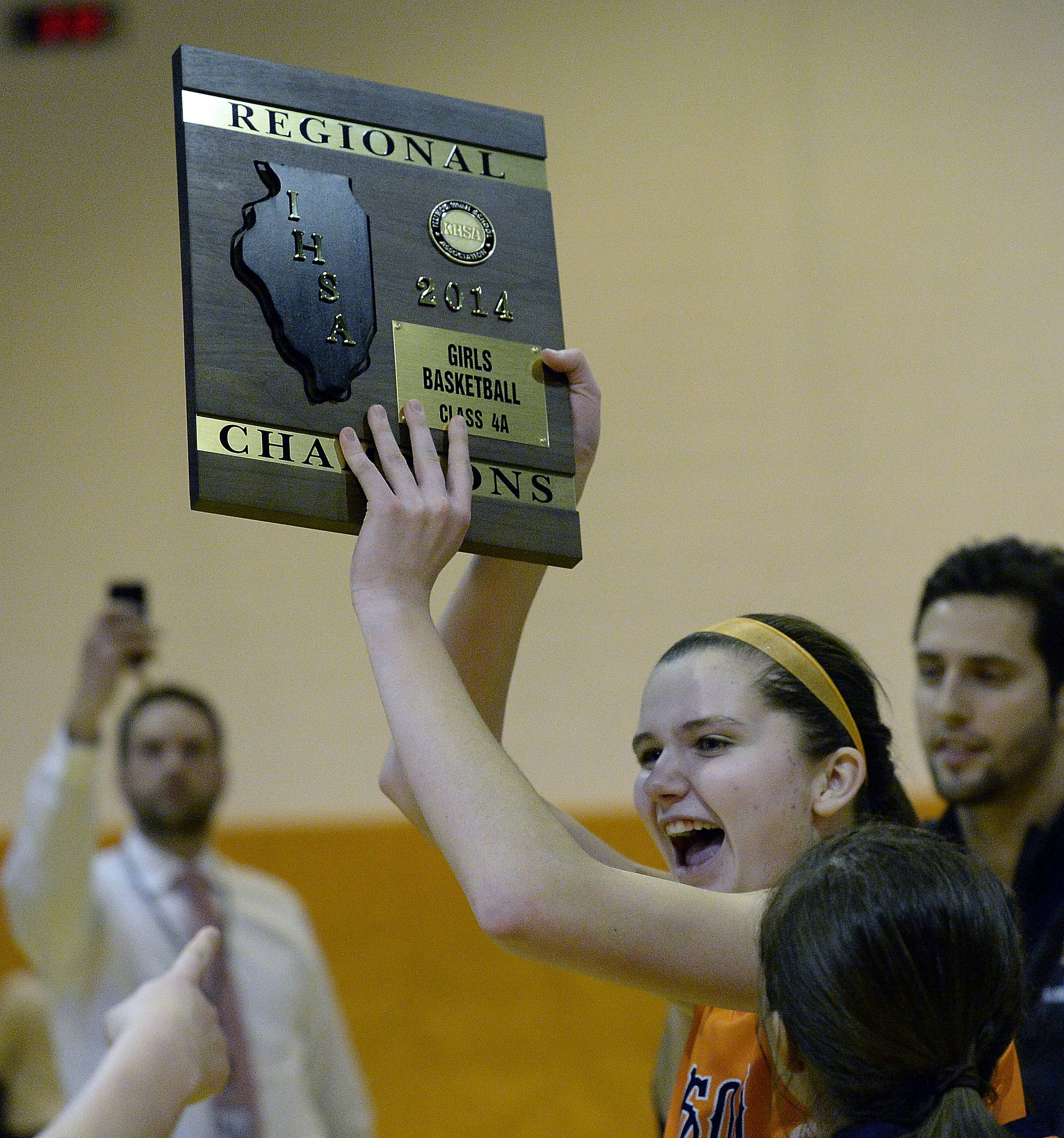 Buffalo Grove's Courtney Myer (20) celebrates the Bison's OT victory against Prospect in Class 4A regional championship action Thursday at Buffalo Grove.