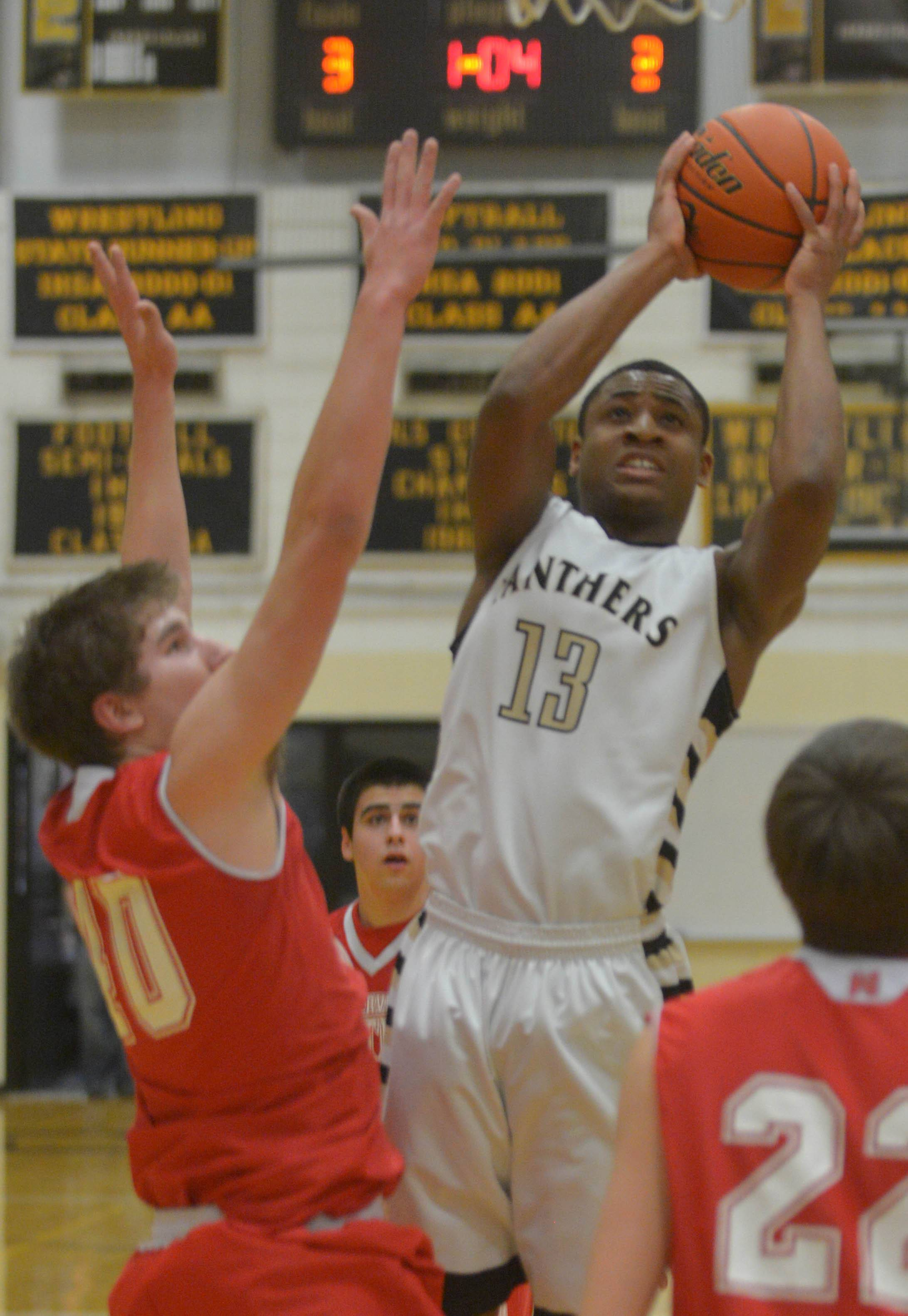Justin Chamberlain of Glenbard North puts up a shot against Naperville Central Friday.