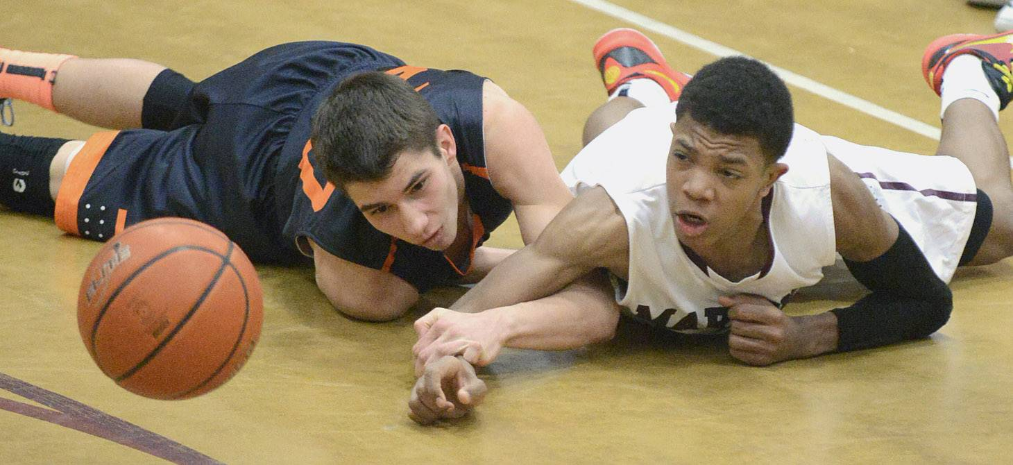 St. Charles East's Jake Clodi and Elgin's Donte Harper scramble on the floor for a loose ball in the second quarter on Friday.