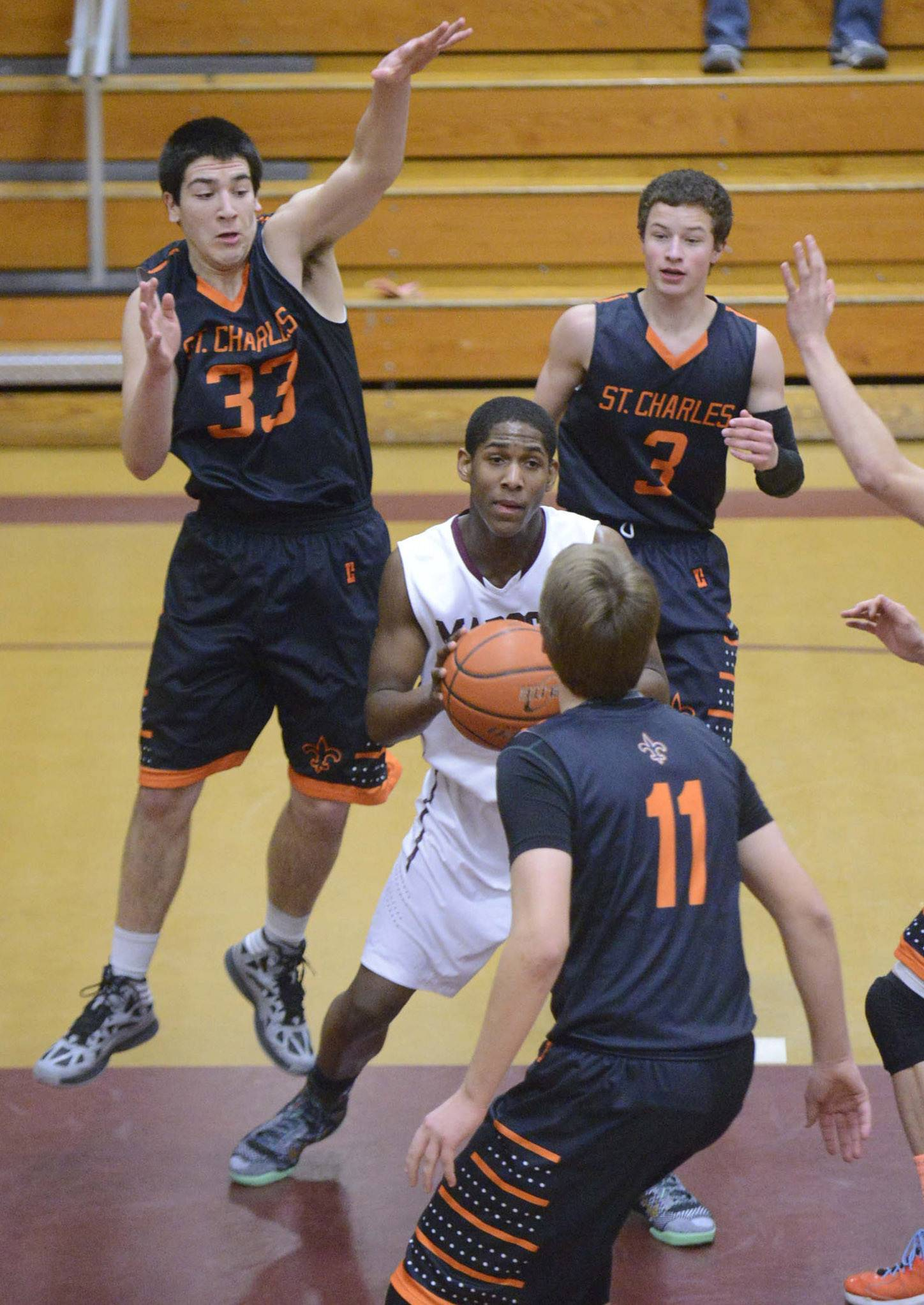 Images from the St. Charles East at Elgin boys basketball game Friday, February 21, 2014 in Elgin.