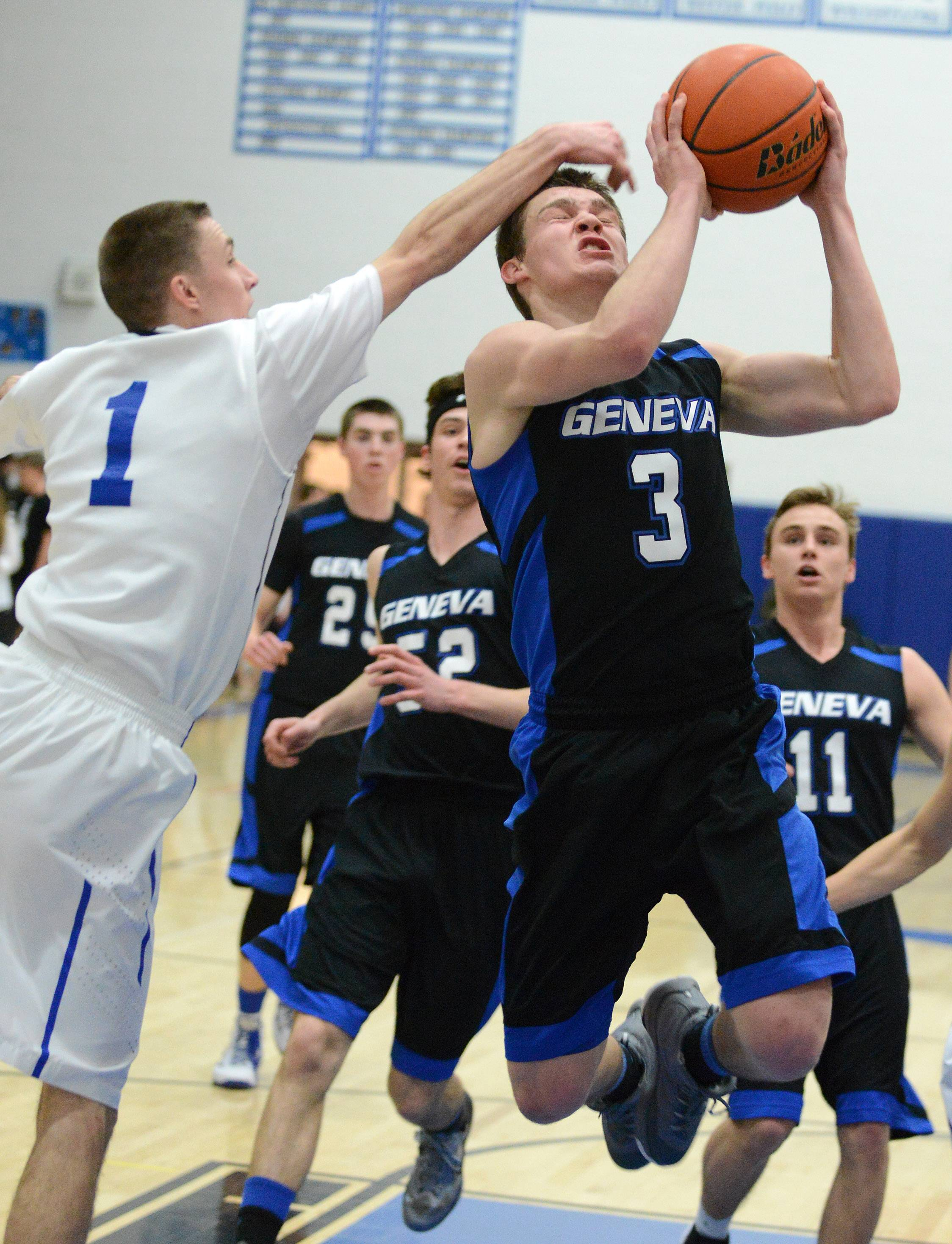 Geneva's Pace Temple scores and is fouled by St. Charles North's Alec Goetz .