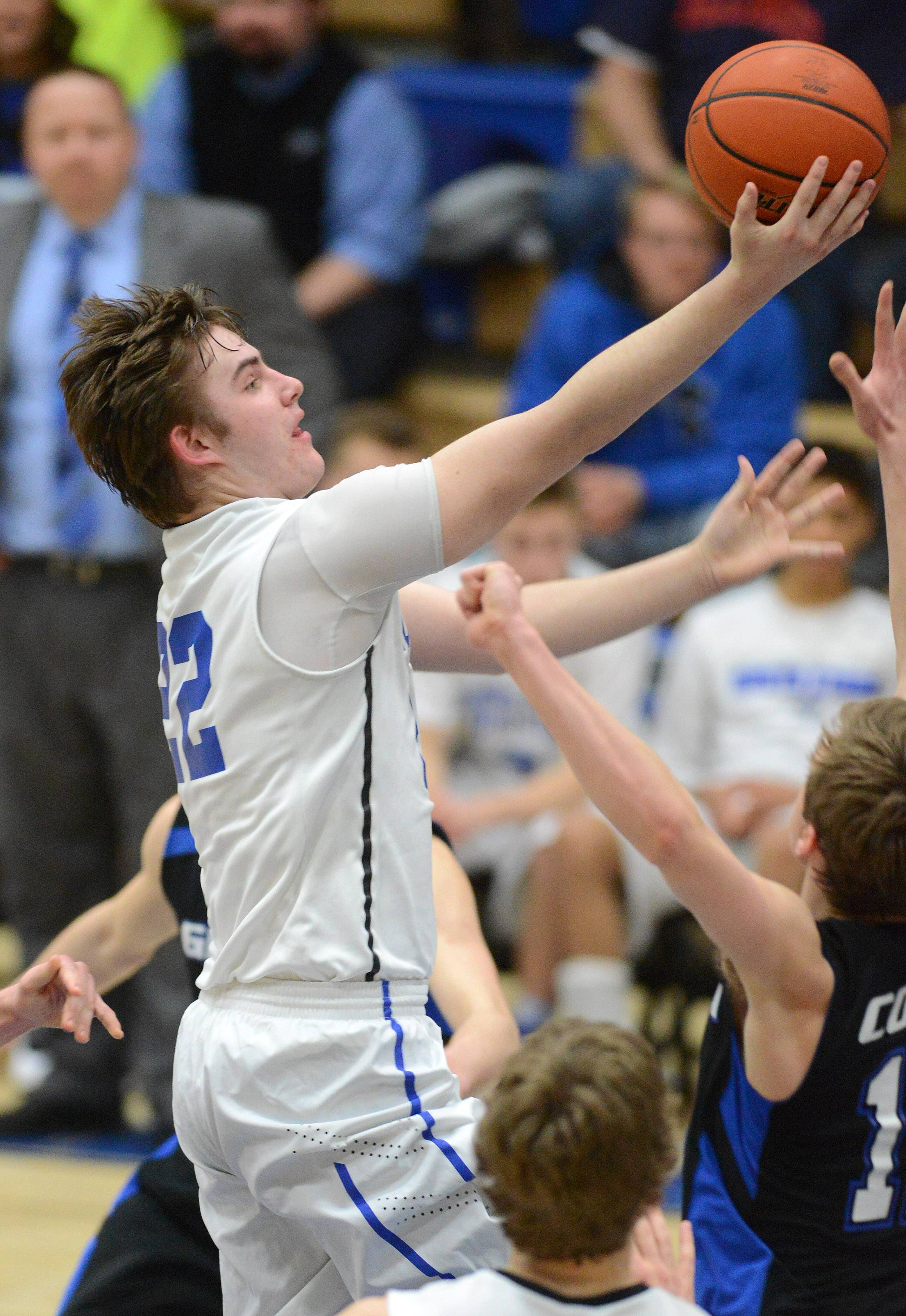 St. Charles North's Jack Callaghan drives and scores against Geneva.