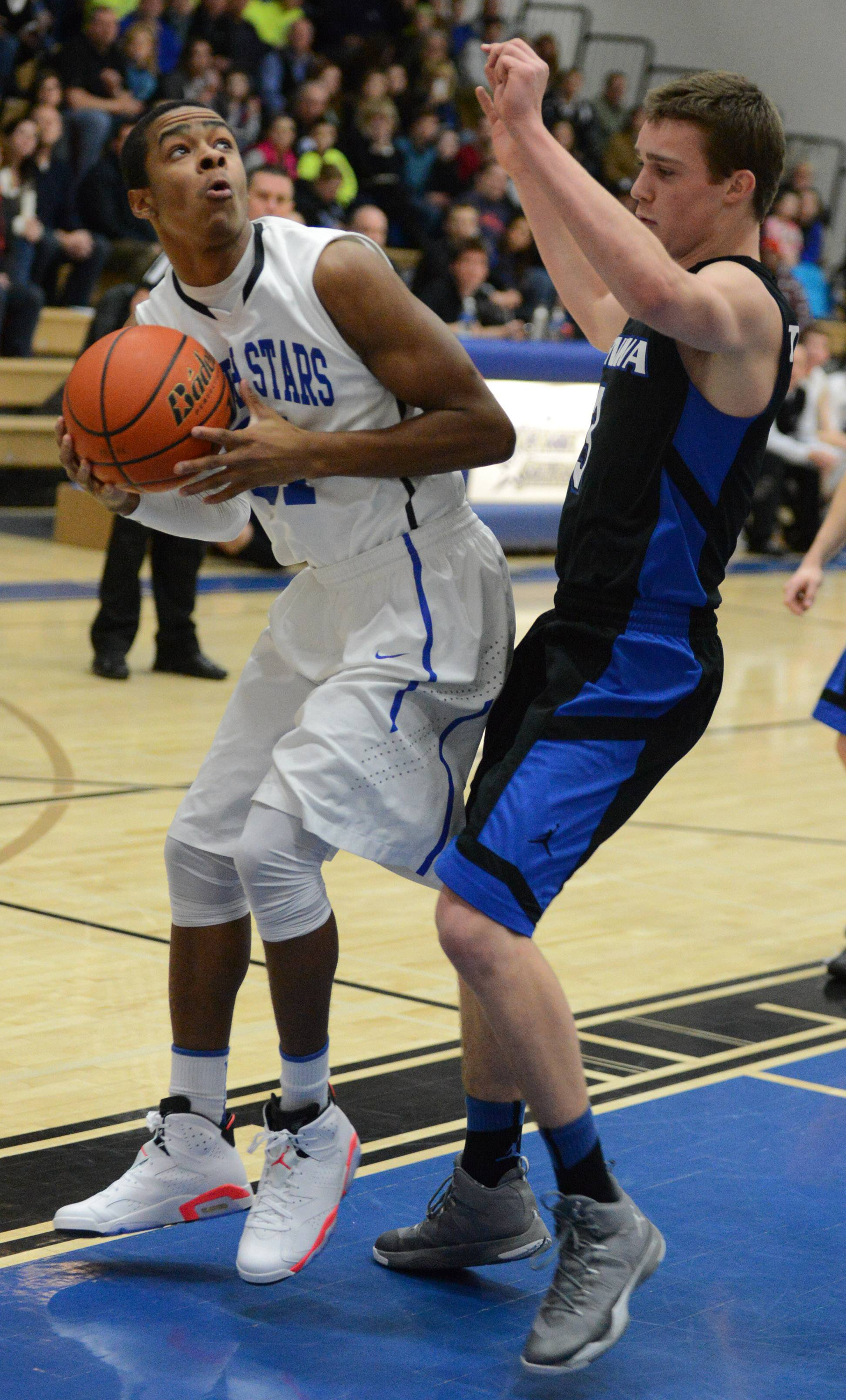 Images from the Geneva at St. Charles North boys basketball game Friday, February  21, 2014 in St. Charles.