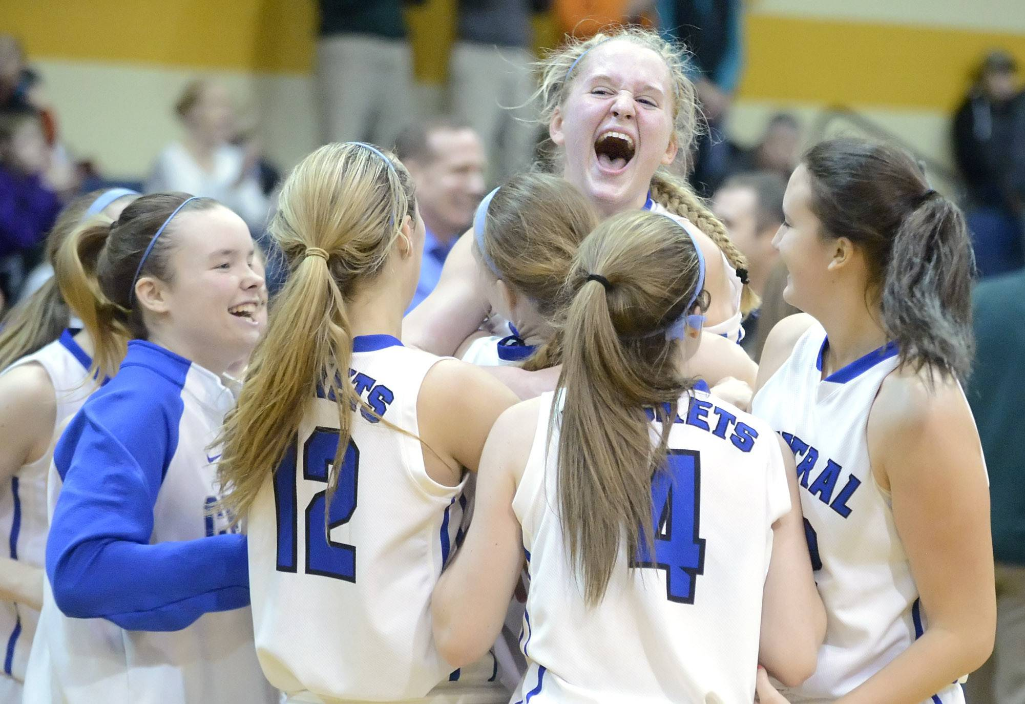 Burlington Central's Samantha Pryor screams as she leaps into the arms of teammates after their win over St. Edward in the Class 3A regional championship game on Saturday, February 22.
