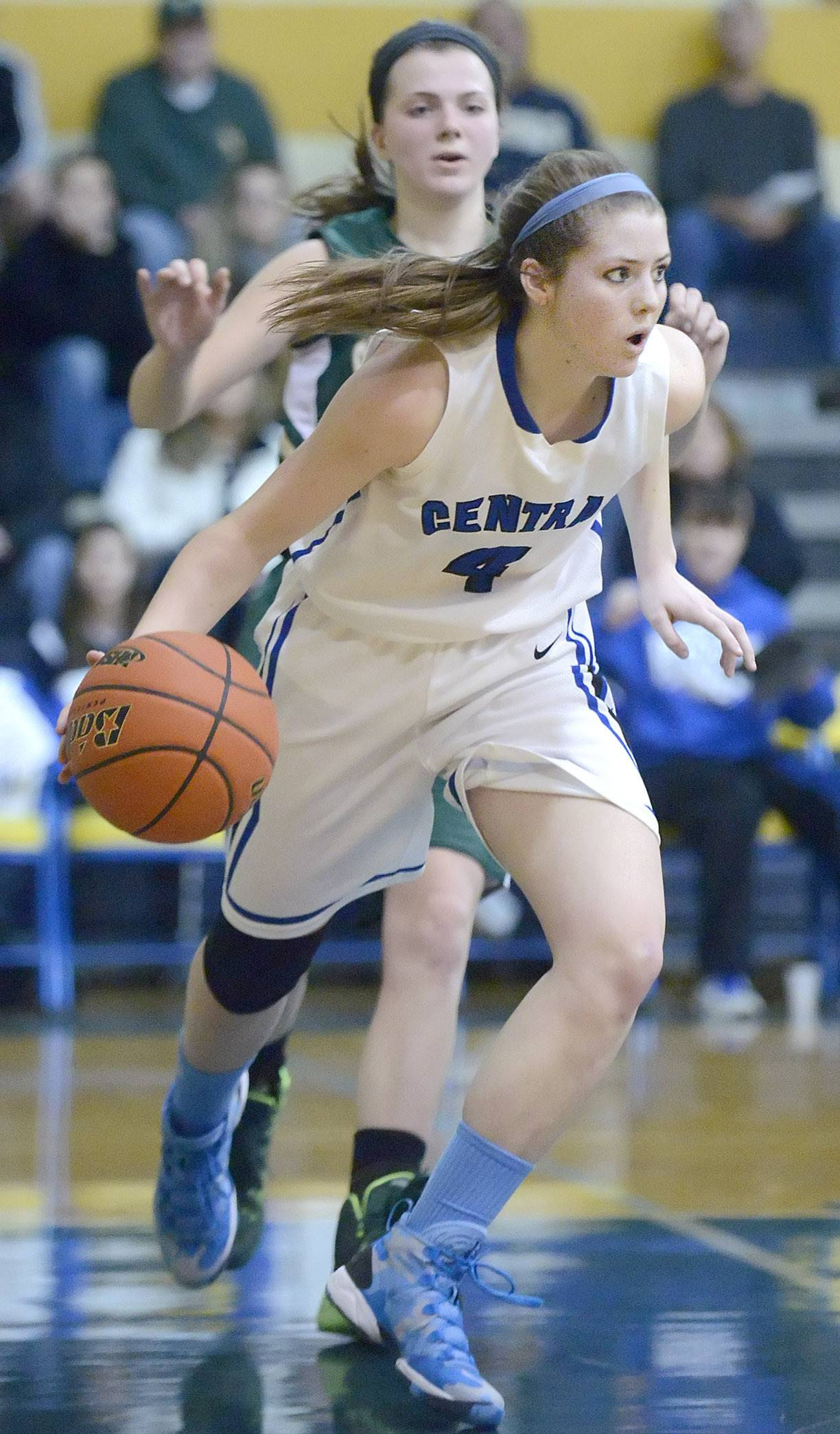 Burlington Central's Kayla Ross swipes a rebound and takes off past St. Edward's Katie Swanson in the fourth quarter of the Class 3A regional championship game on Saturday, February 22.