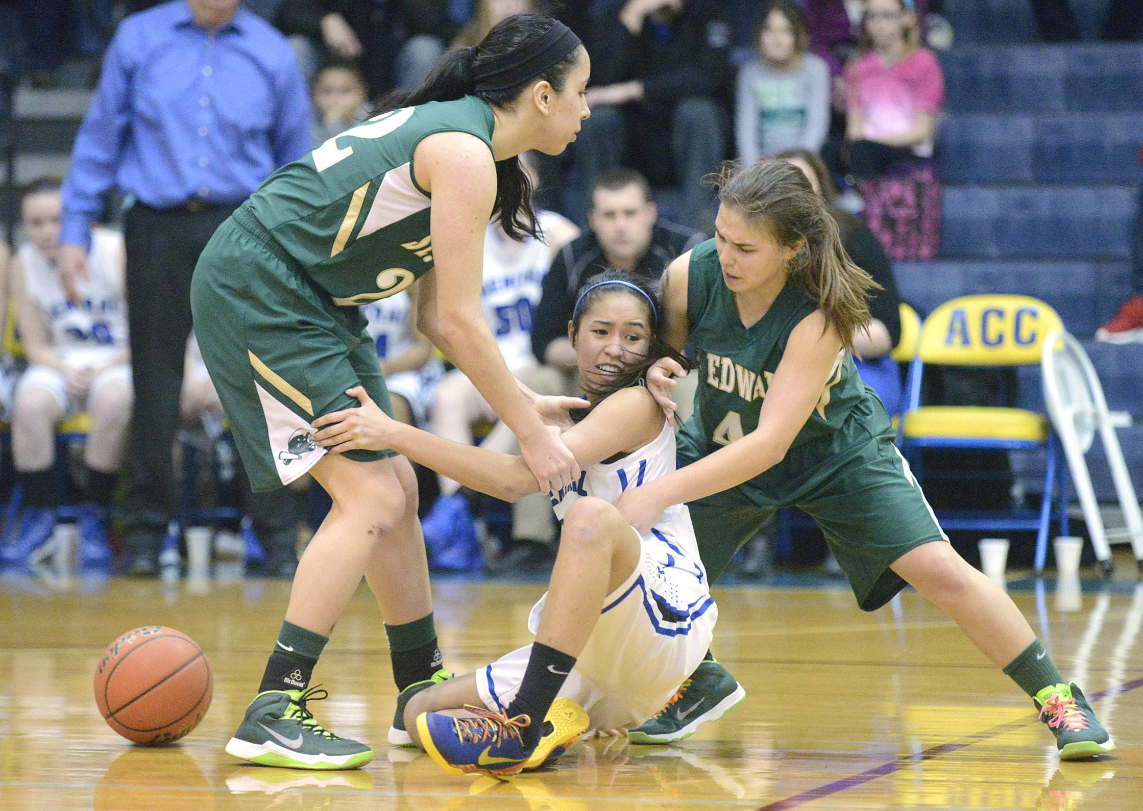 Burlington Central's Samantha Cruz is blocked from regaining the ball by St. Edward's Clarissa Ramos, left, and Madelyn Spagnola, right, in the fourth quarter of the Class 3A regional championship game on Saturday, February 22.