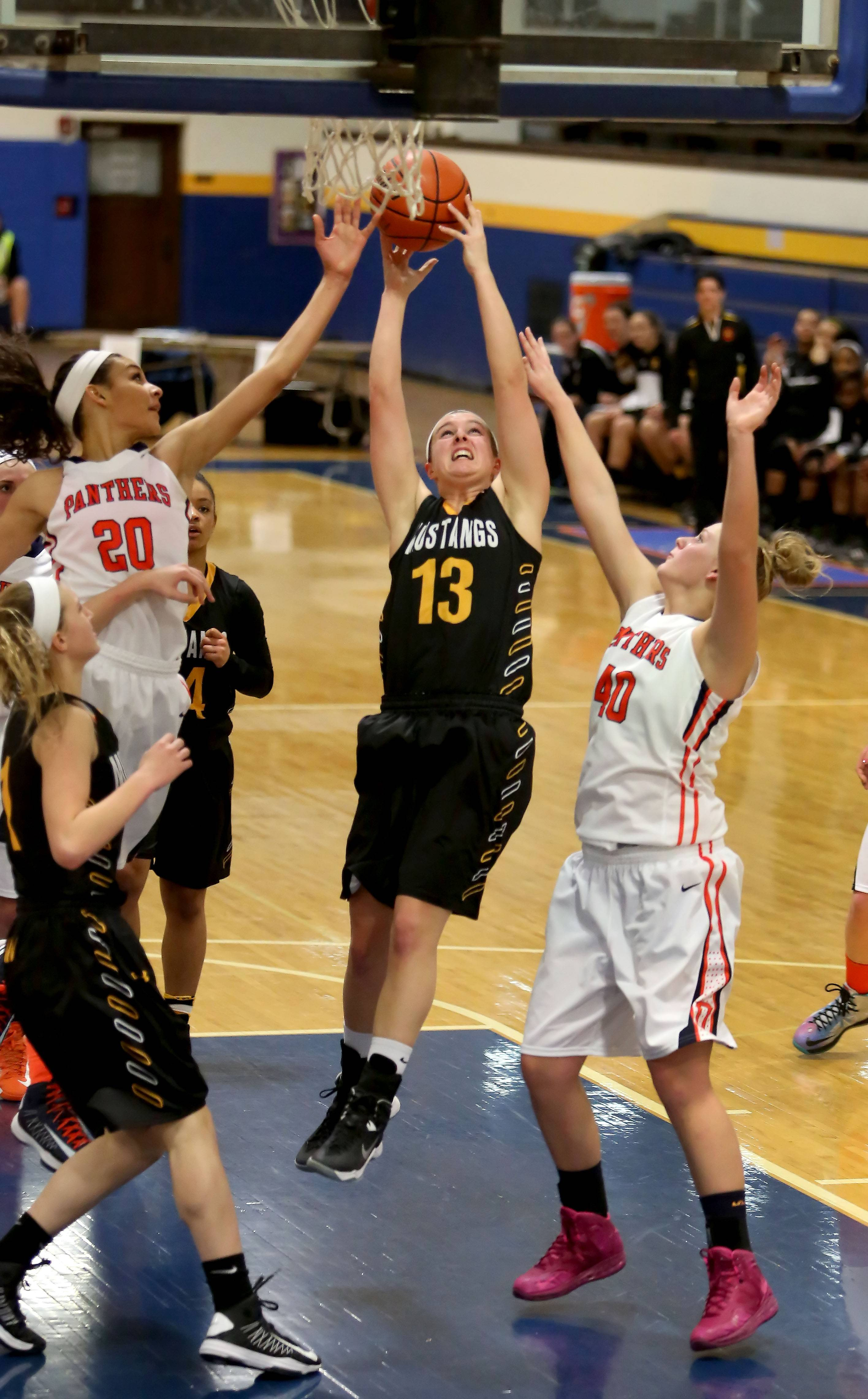 Metea Valley's Katie Lawrence goes for a rebound.