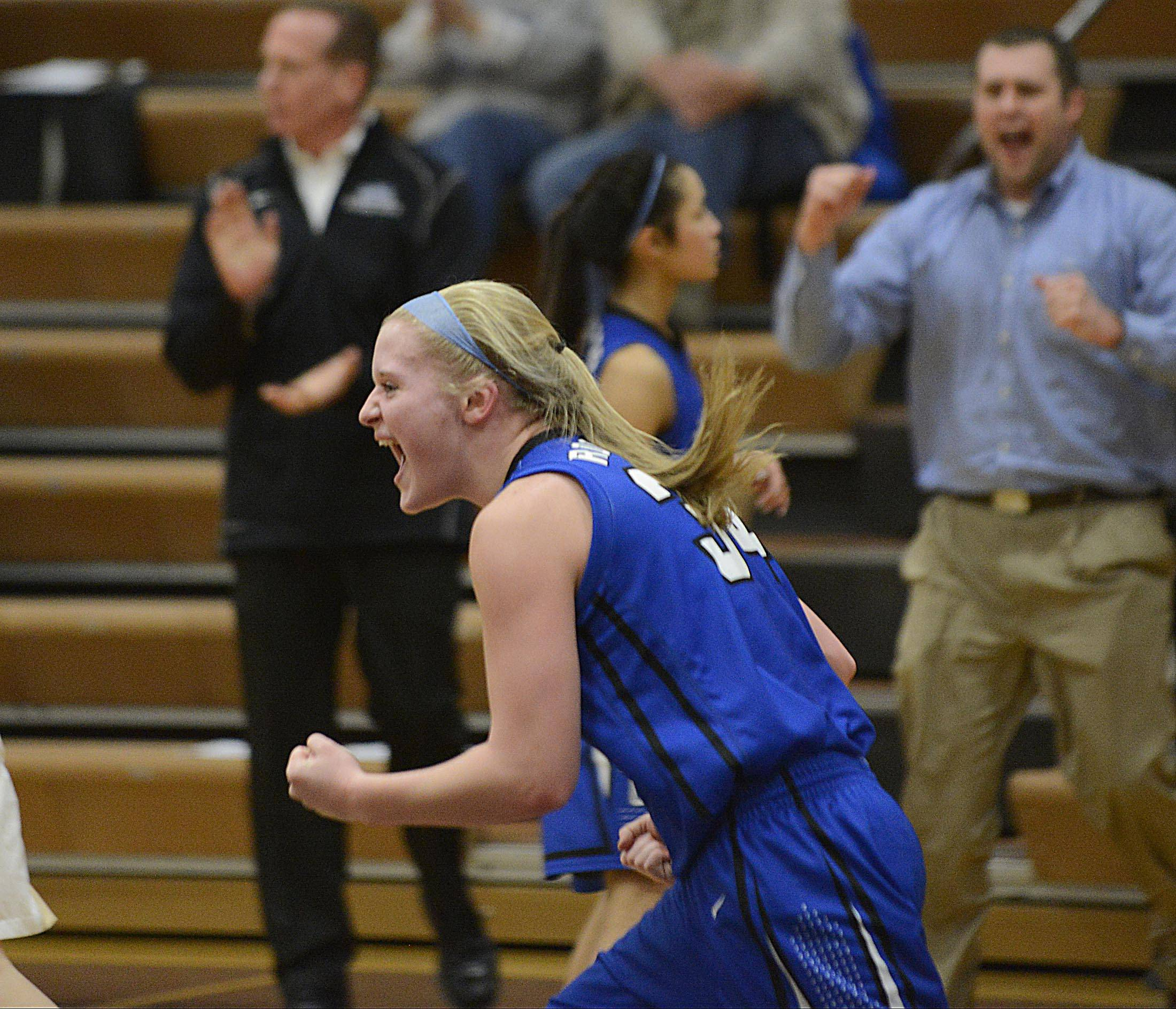 Burlington Central's Sam Pryor celebrates a Rockets' basket during Monday's Class 3A Belvidere sectional win over Sycamore.