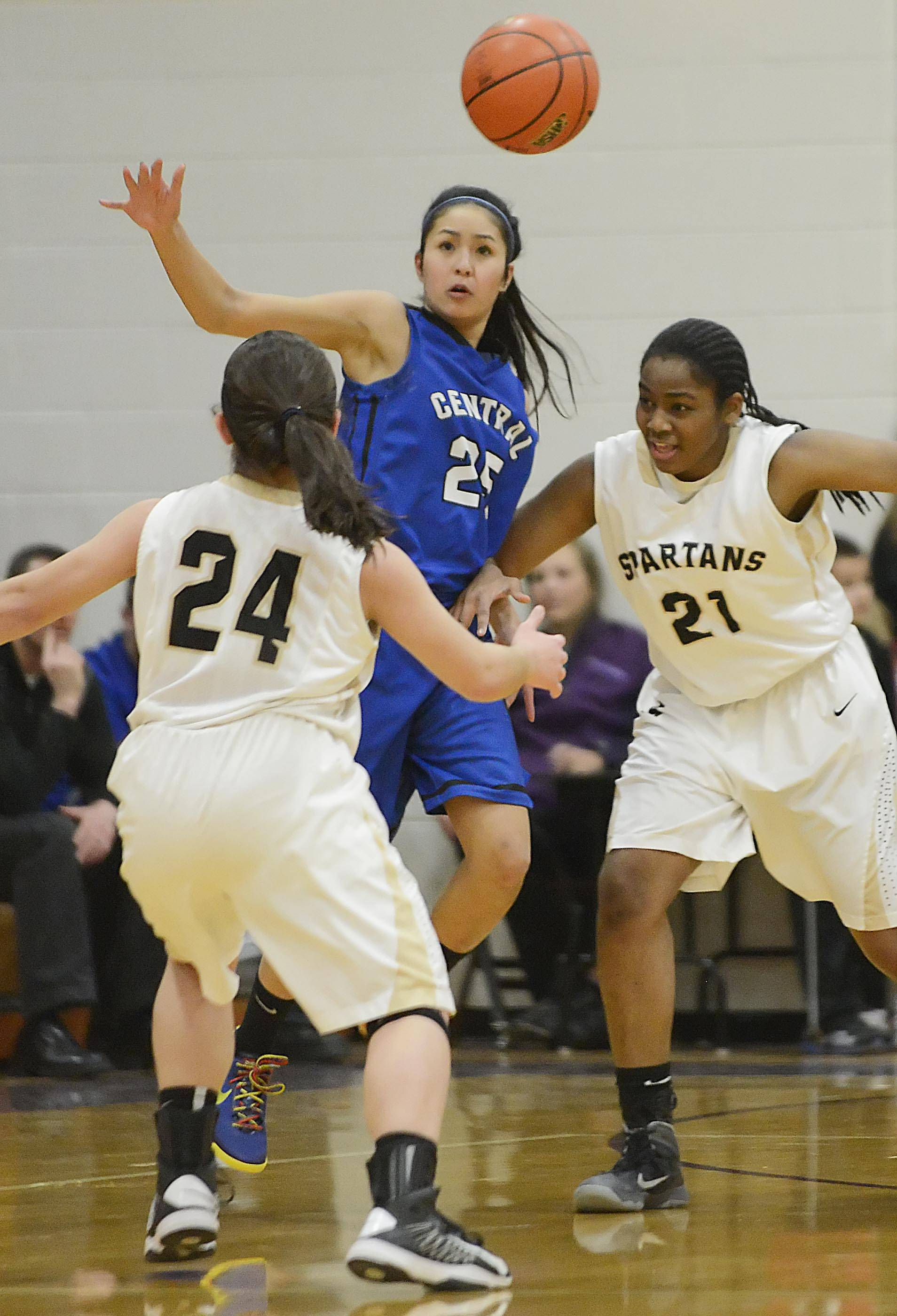 Burlington Central's Samantha Cruz disrupts a pass between Sycamore's Julia Moll and Taiya Hopkins Monday in the Class 3A Belvidere sectional.
