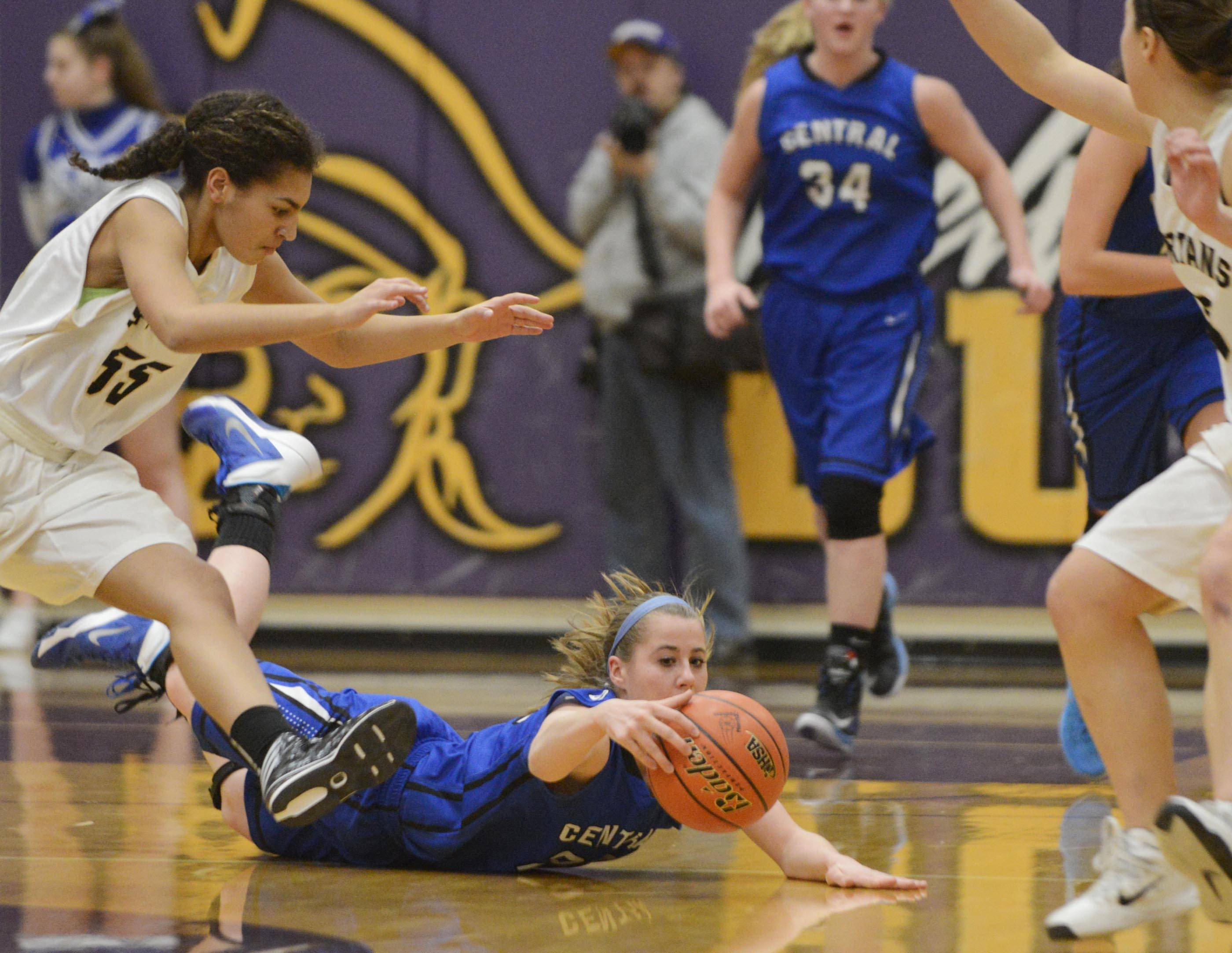 Burlington Central's Aly DeTamble dives on a loose ball between Sycamore players Monday in the Class 3A Belvidere sectional.