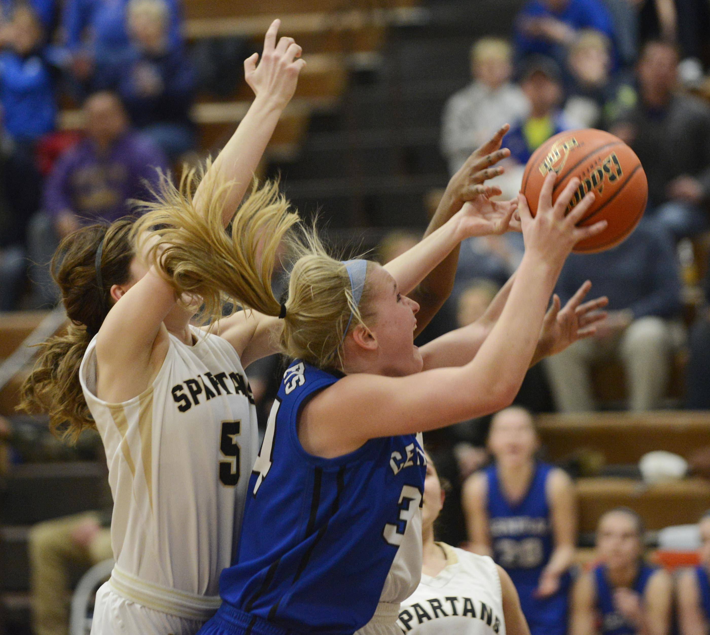 Burlington Central's Samantha Pryor grabs a rebound in a host of Sycamore players Monday in the Class 3A Belvidere sectional.