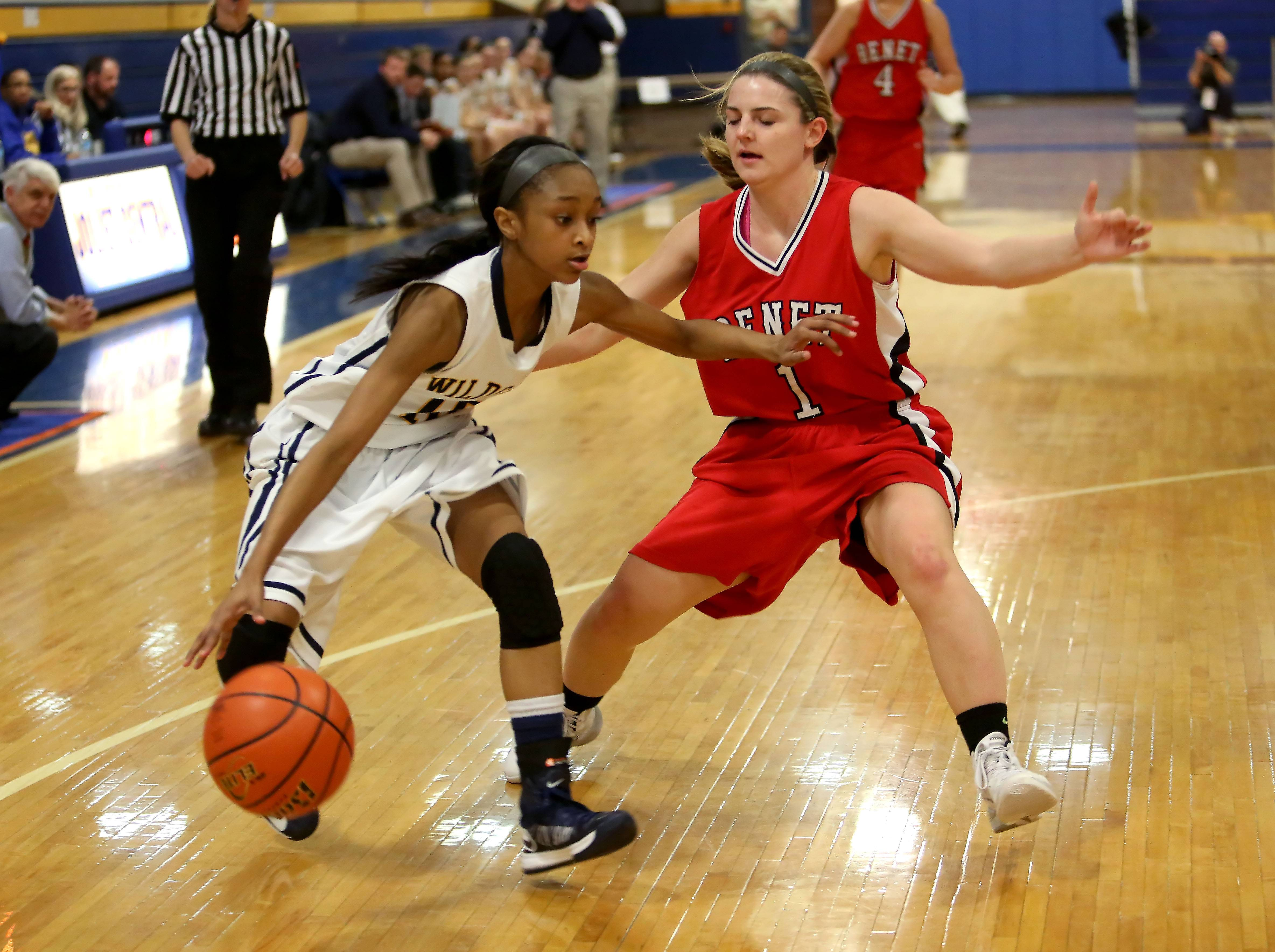 Neuqua Valley's Myia Starks, left, takes the ball around Morgan Thomalia of Benet Academy.