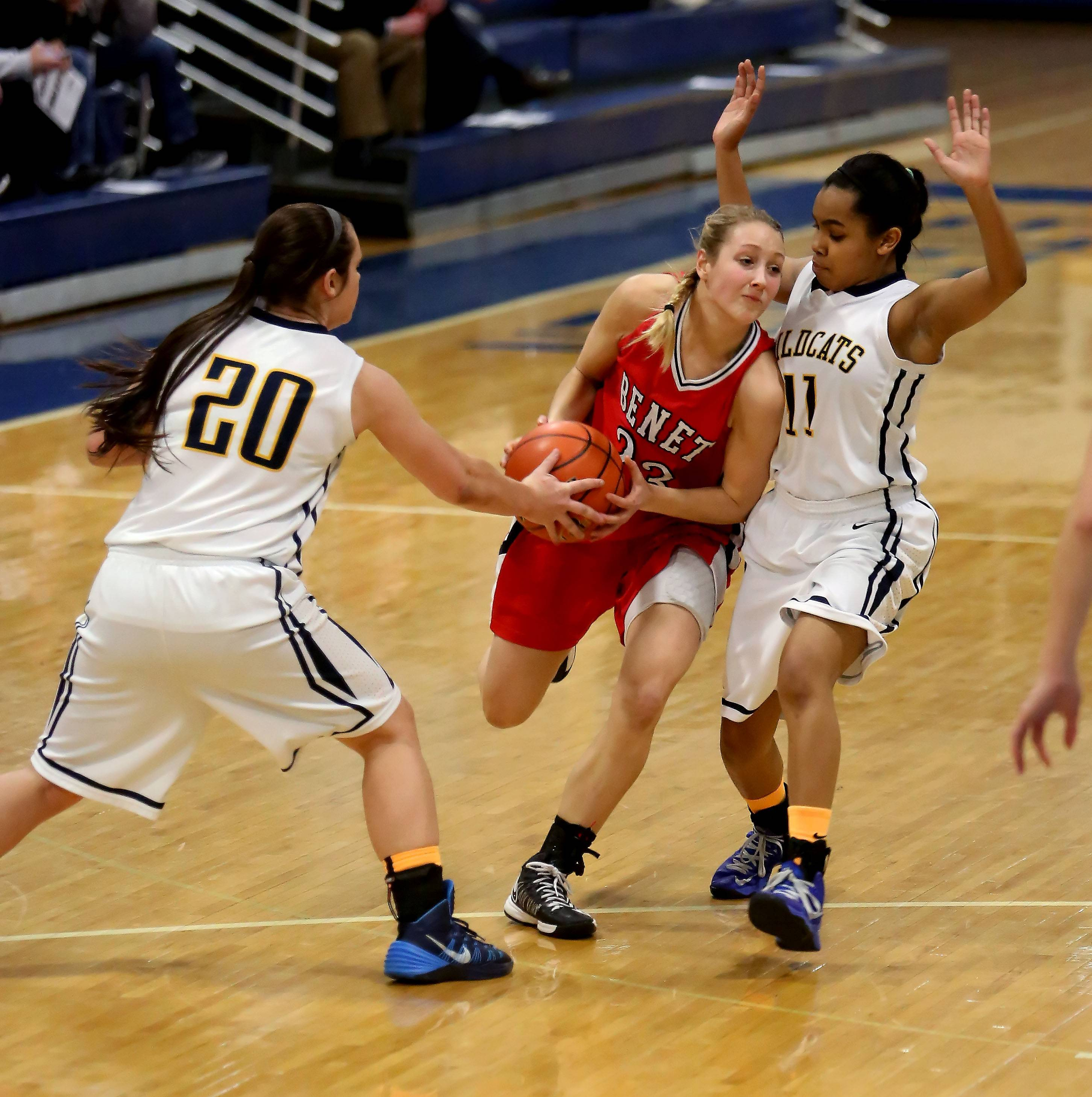 Benet Academy's Emily Eshoo, center, gets caught in between Kai Moon, right and Niki Lazar, left, of Neuqua Valley.