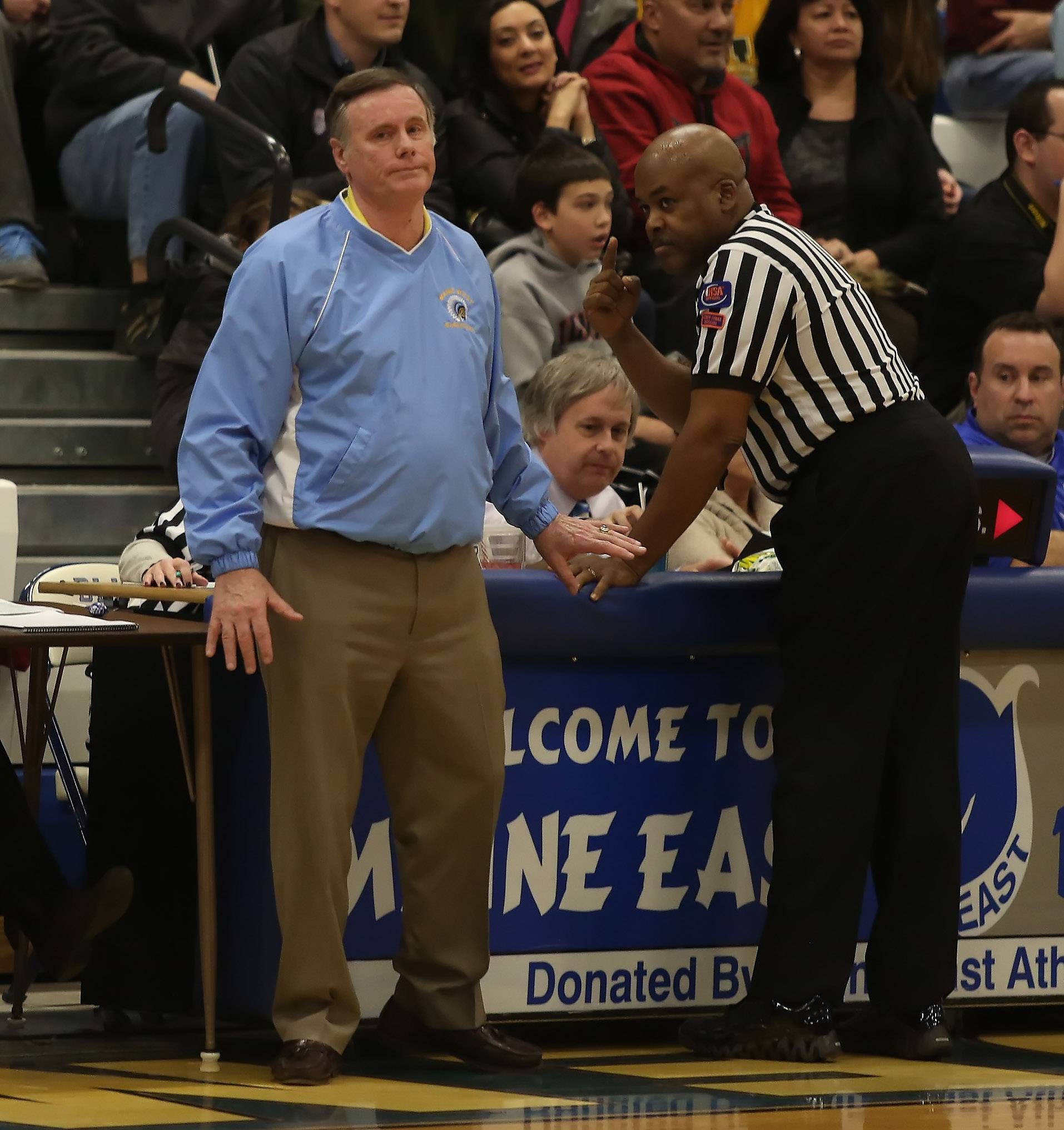 Maine West caoch Derril Kipp is given a technical foul by referees after he argued a decision by referees when New Trier guard Megan Neuhaus hit a shot from midcourt at the end of the third quarter.
