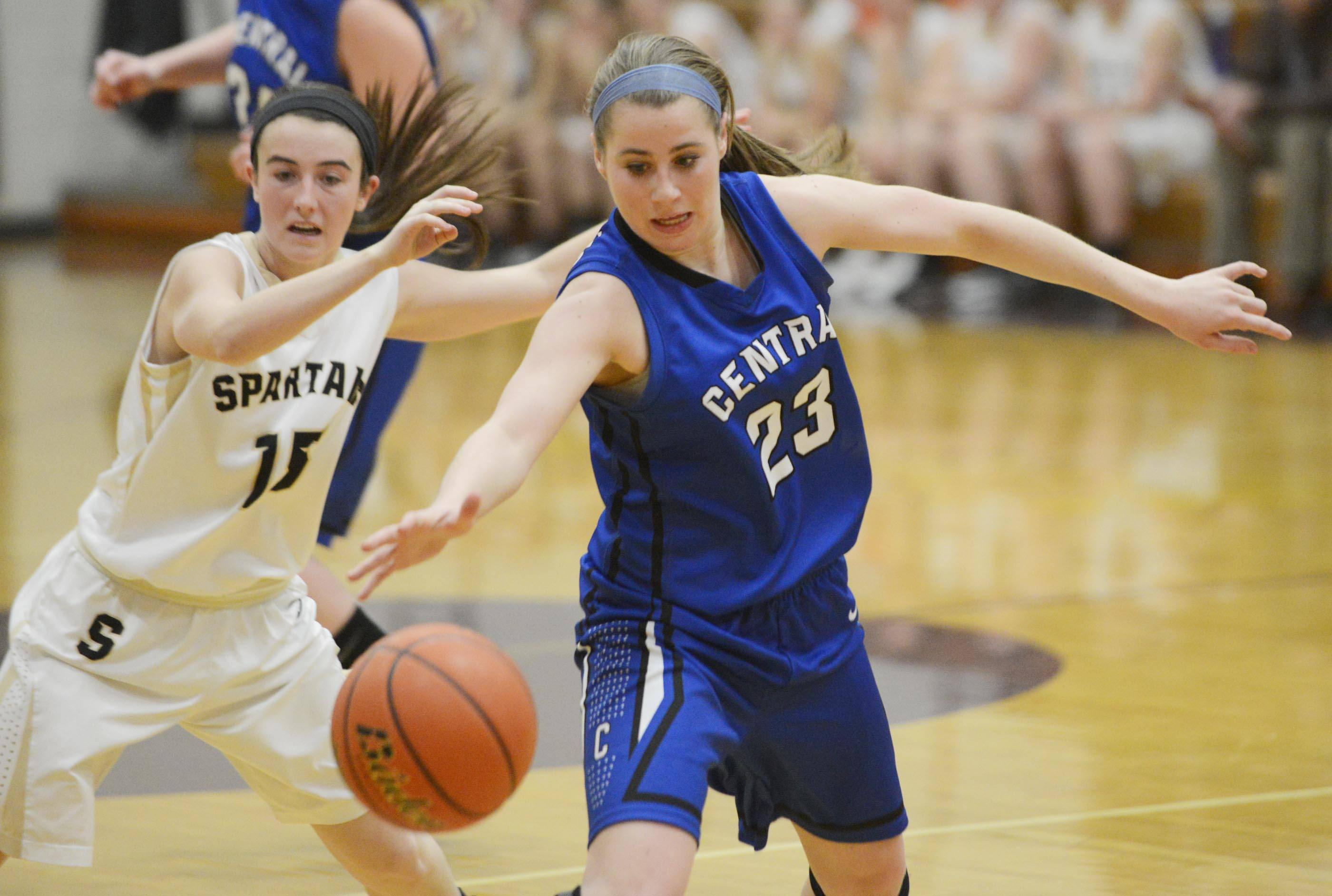 Burlington Central's Aly DeTamble steals a pass intended for Sycamore's Lauren Goff .