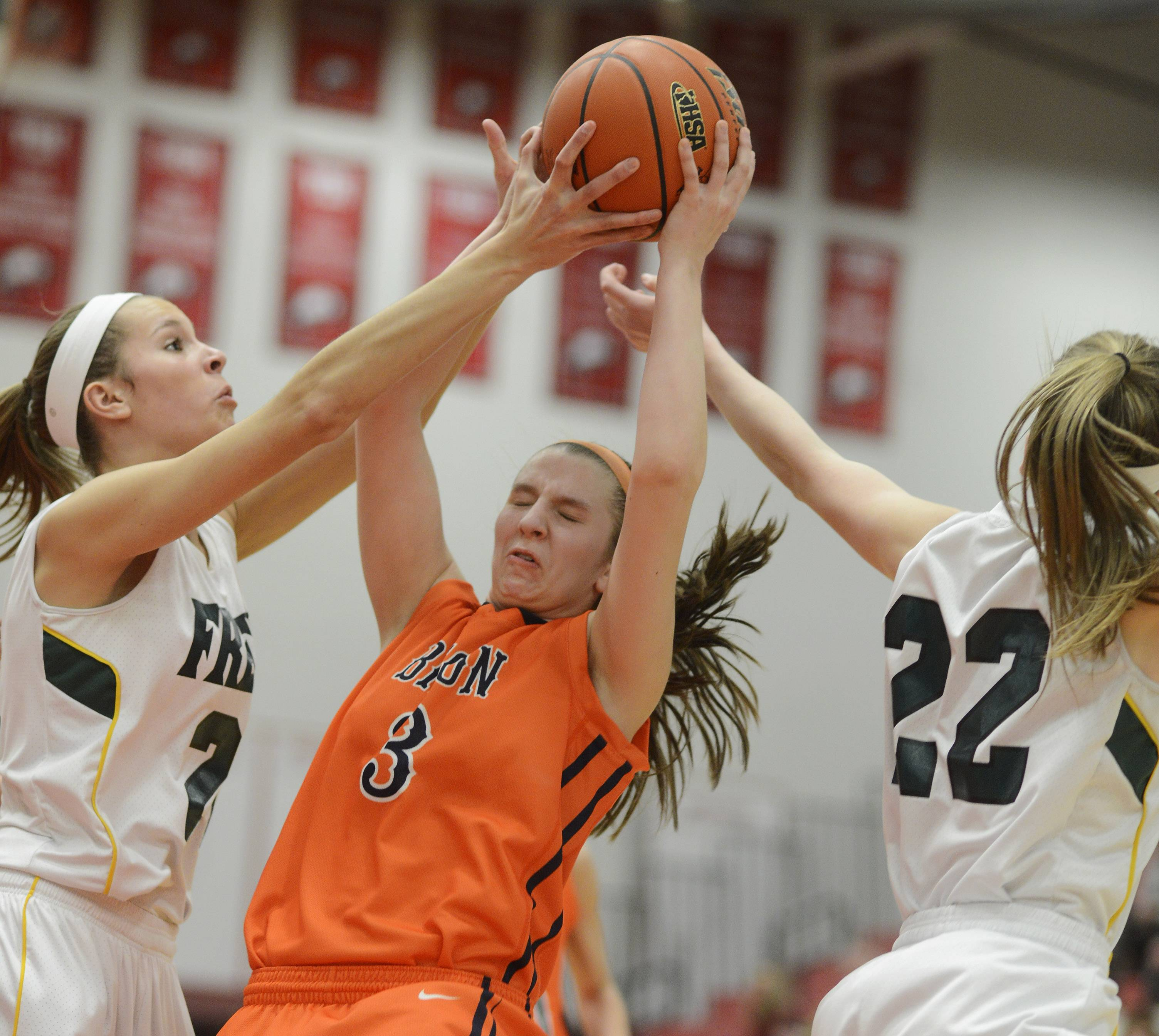 Buffalo Grove's Maddie Welter, middle, gets between Fremd's Grace Twrek, left, and Erin Lenahan for a rebound during the Class 4A sectional semifinal at Barrington on Tuesday.