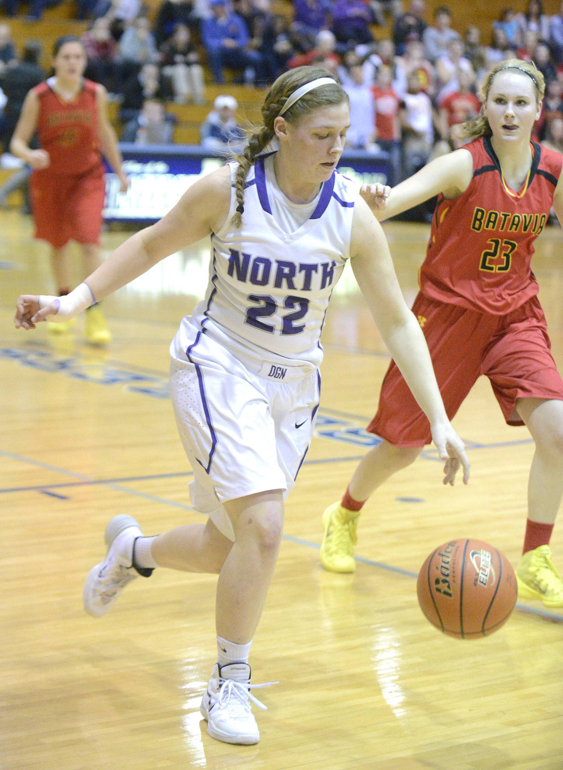Downers Grove North's Colleen Honn drives the ball past Batavia's Shea Bayram in the third quarter of the 4A sectional semifinals at Addison Trail High School in Addison on Tuesday, February 25.