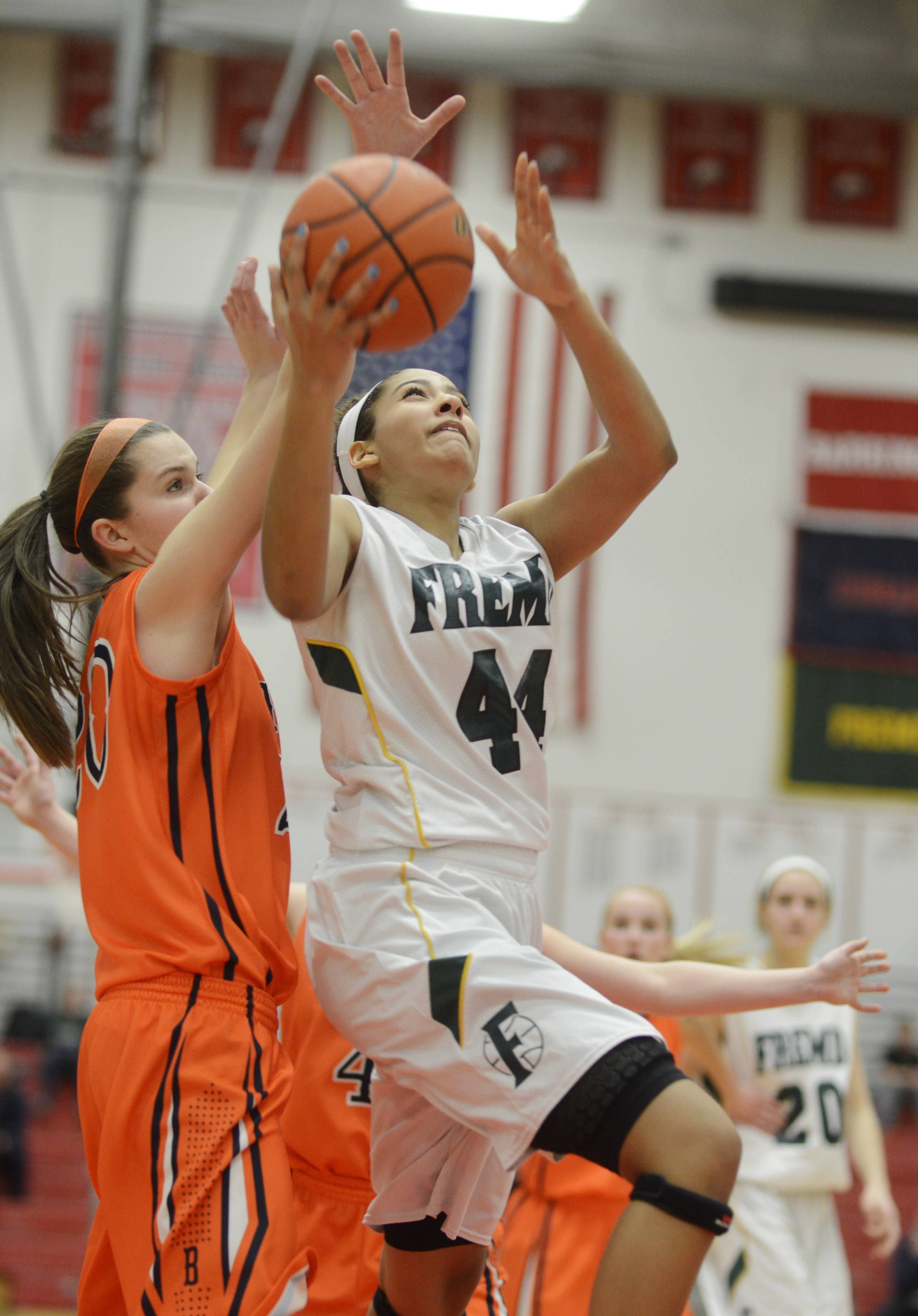 Fremd's Bryana Hopkins, right, drives to the basket against Buffalo Grove's Courtney Meyer.