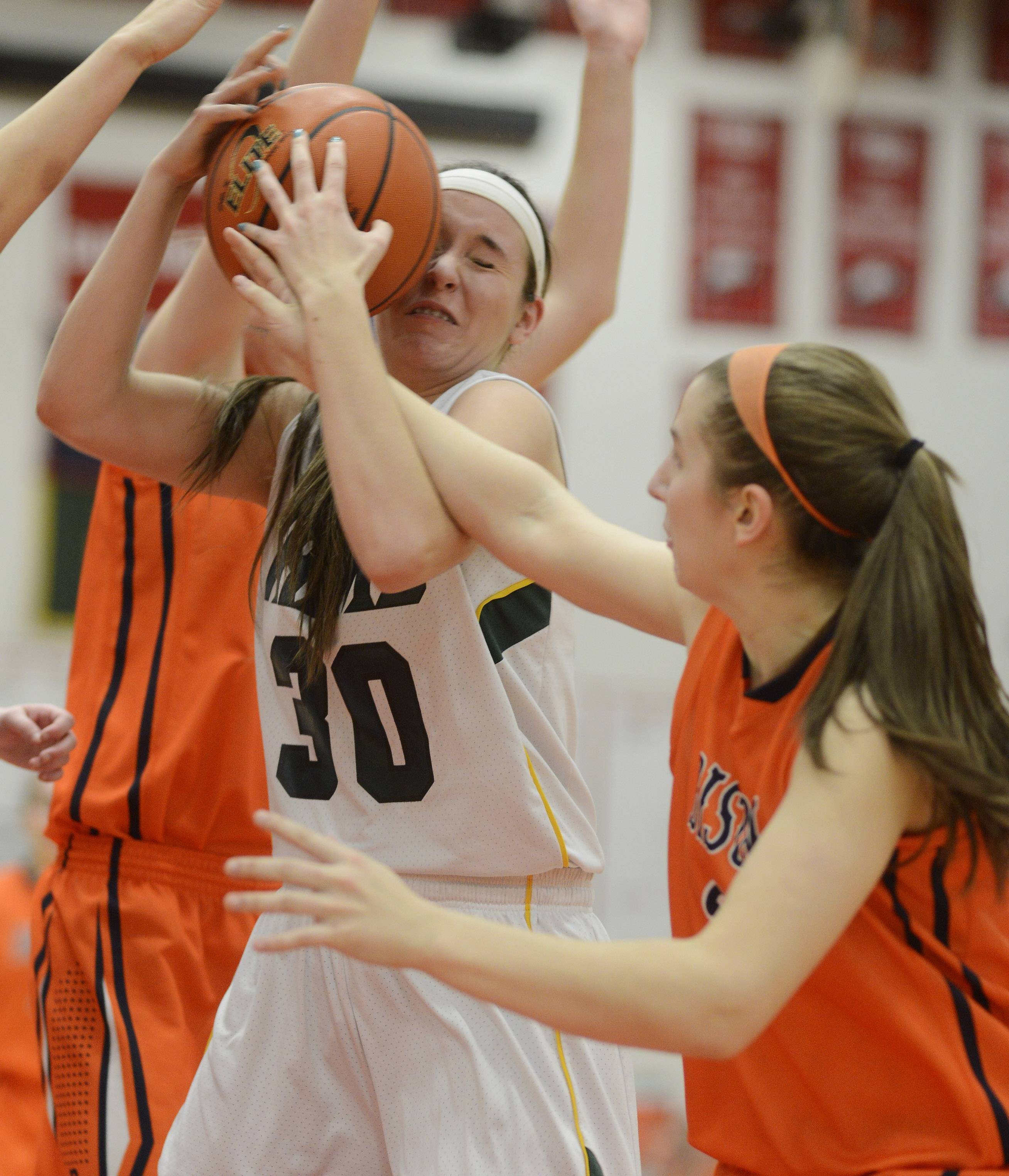 Fremd's Erica Simios, left, draws contact from Buffalo Grove's Maddie Welter.